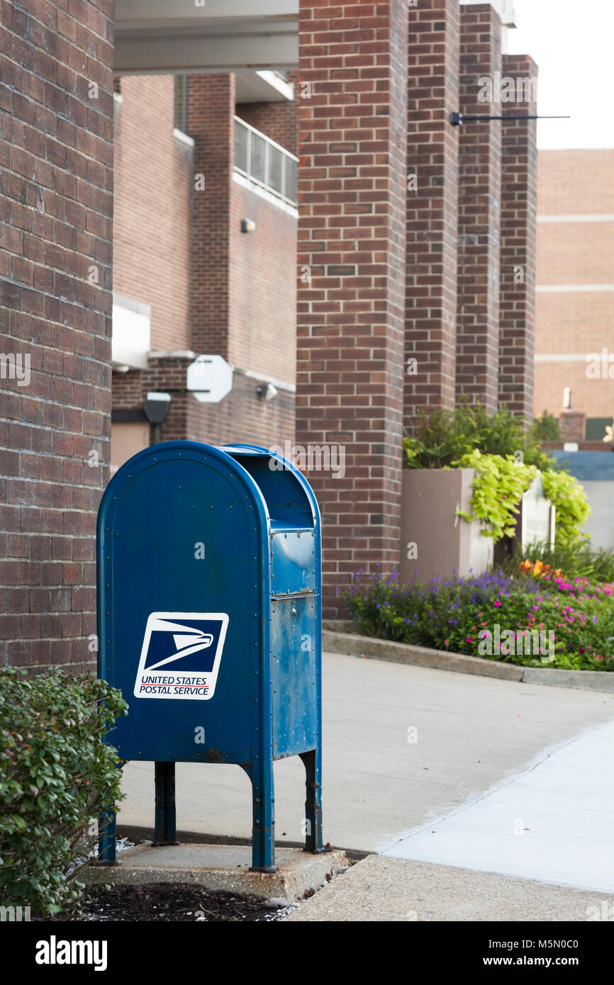 A United States Postal Service blue mailbox in USA America. - Stock Image