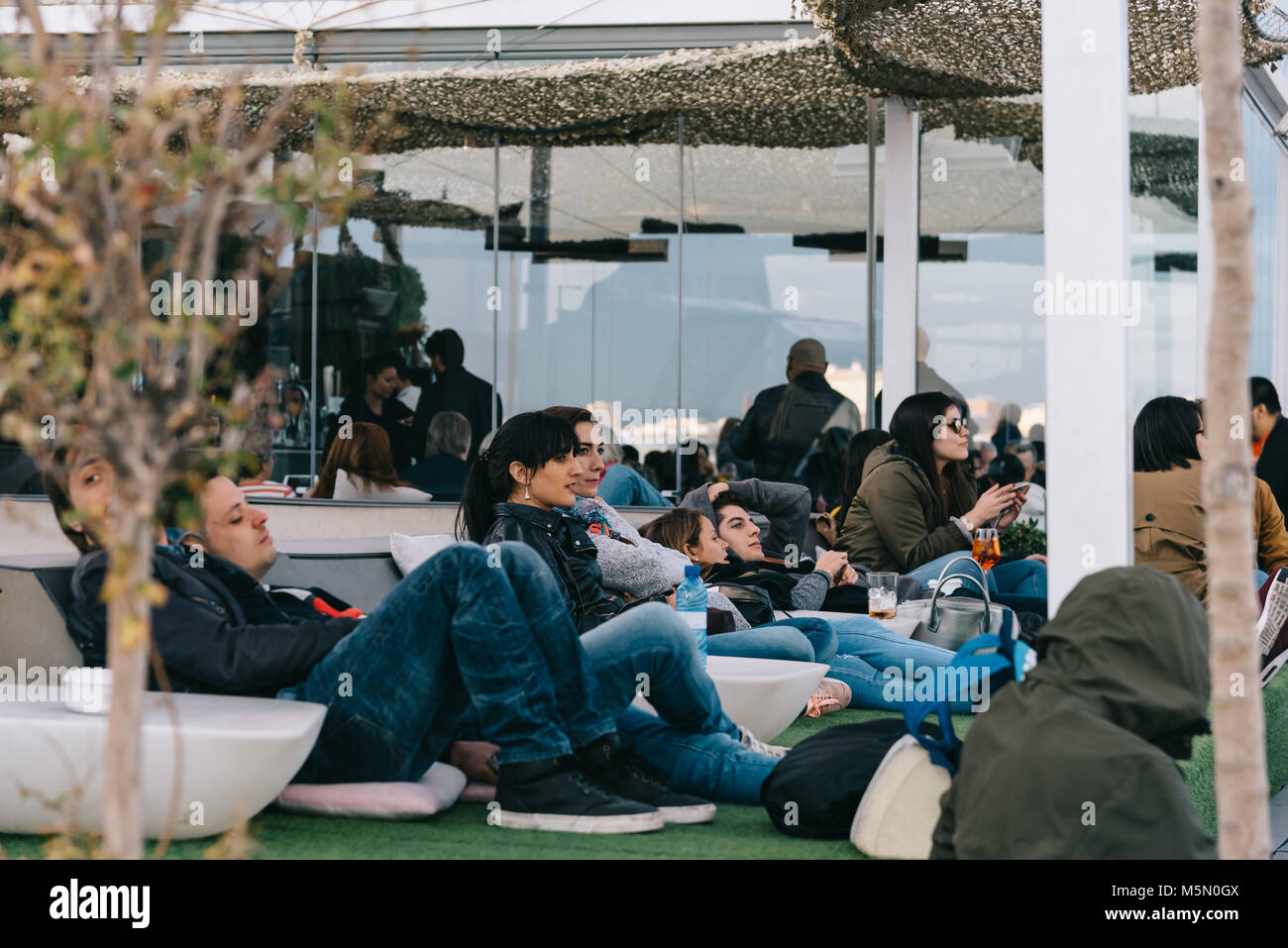 Madrid, Spain - November 3, 2017:  People enjoying at cafe on Circulo de Bellas Artes of Madrid rooftop at sunset. Stock Photo