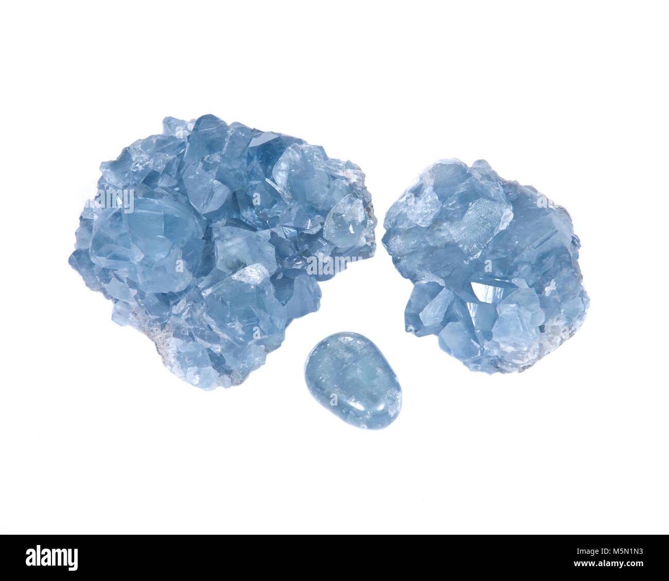Blue celestite cluster and polished celestite palm stone isolated on white background - Stock Image
