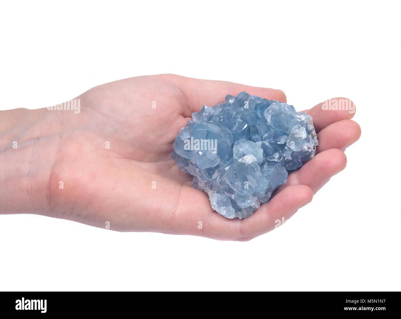 Blue celestite cluster isolated on white background - Stock Image
