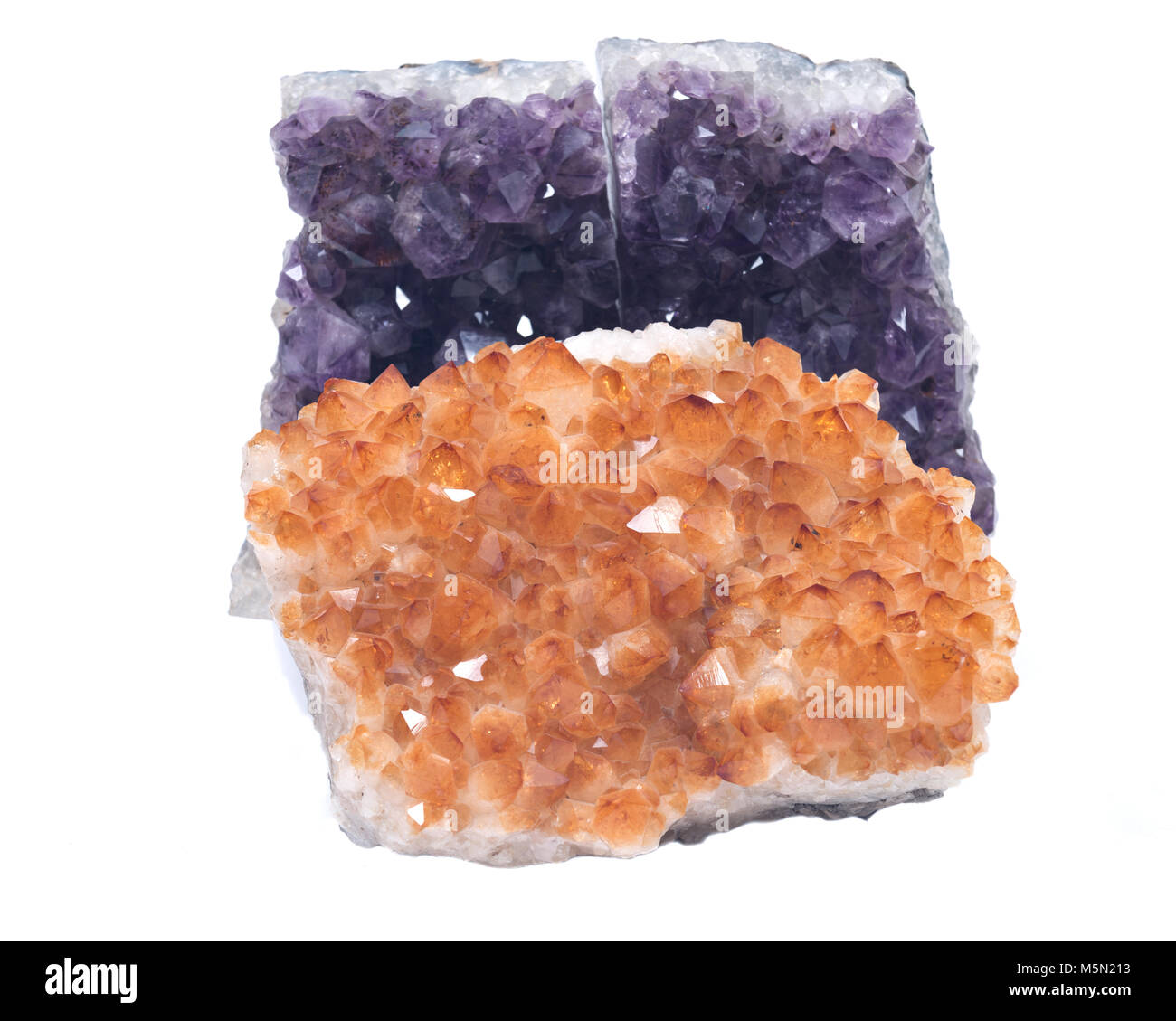 Citrine druzy cluster surrounded by amethyst druzy clusters  isolated on white background - Stock Image