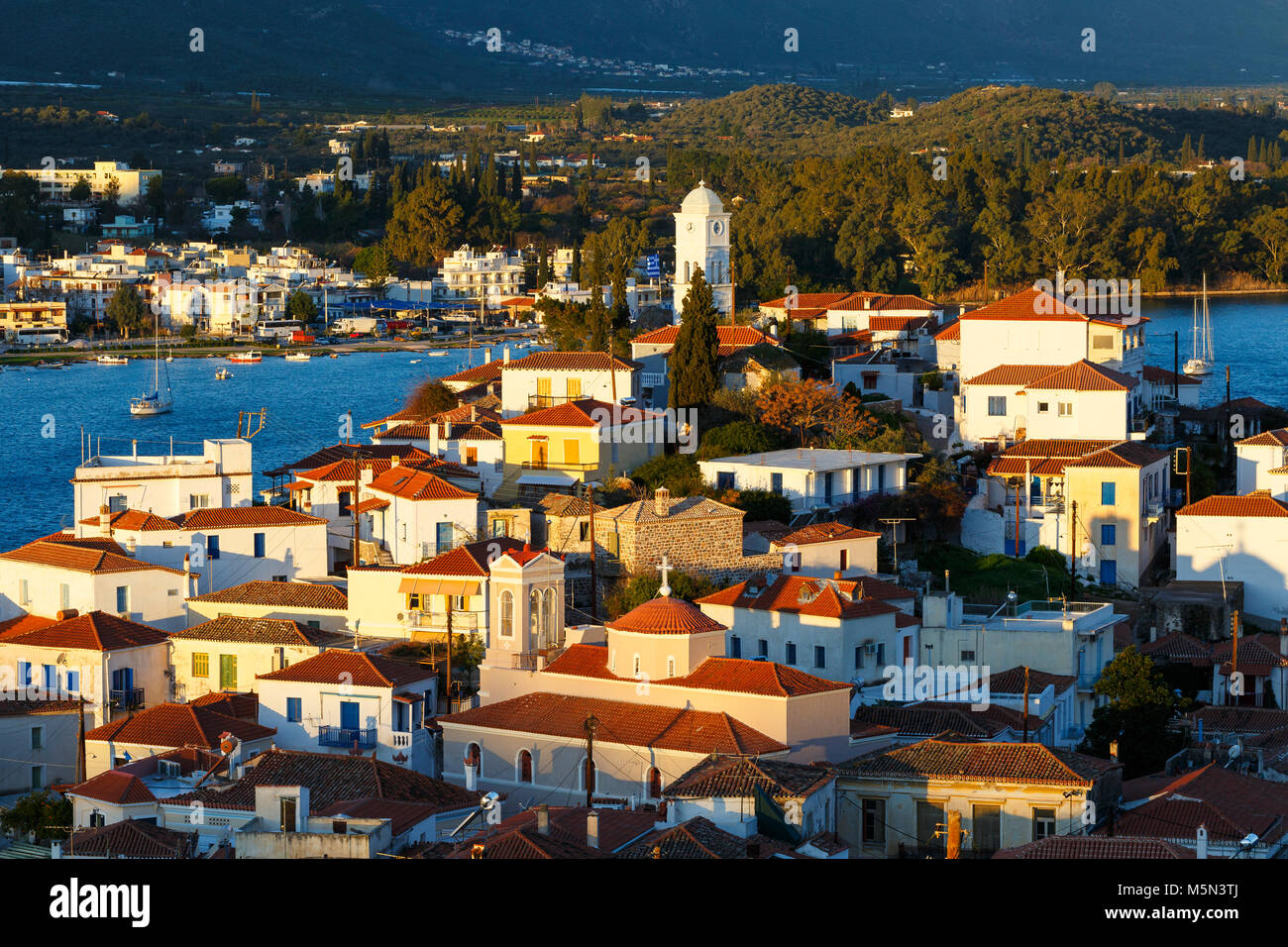 View of Poros island and Galatas village in Peloponnese, Greece. Stock Photo
