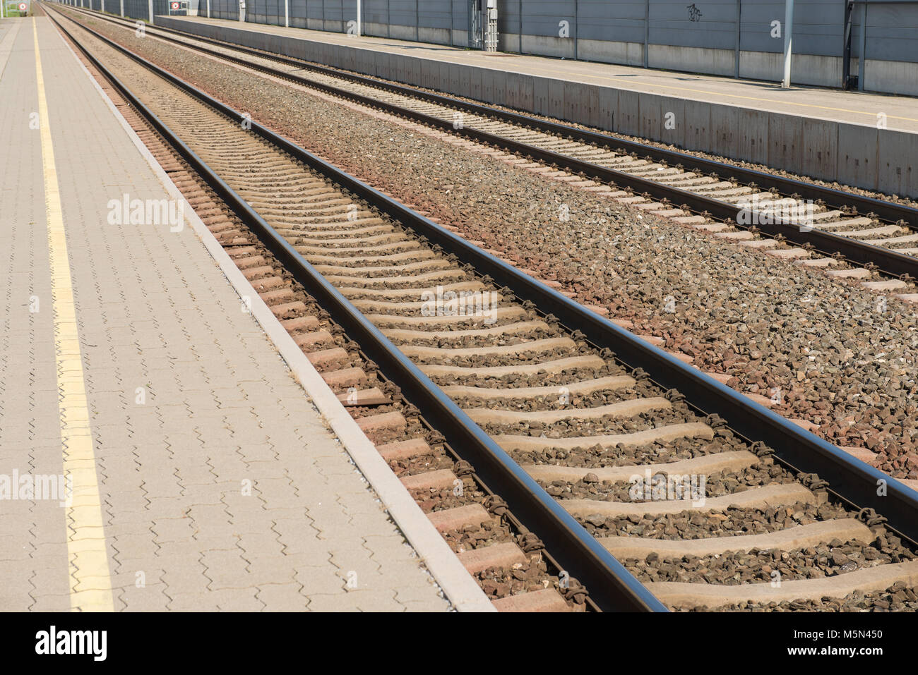 Train tracks and station at Flughafen Graz Feldkirchen with perron - Stock Image
