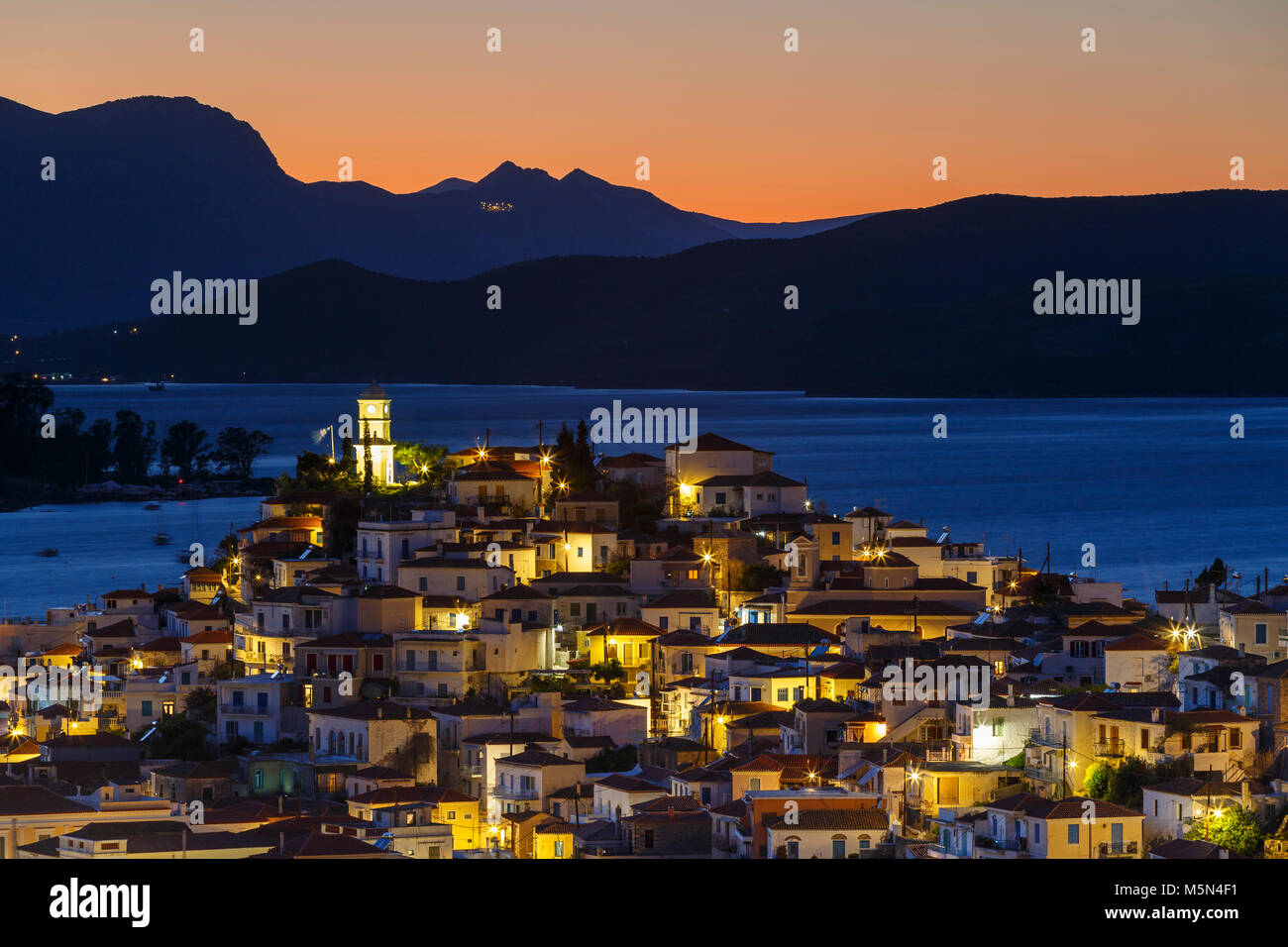 View of Poros island and mountains of Peloponnese peninsula in Greece. Stock Photo