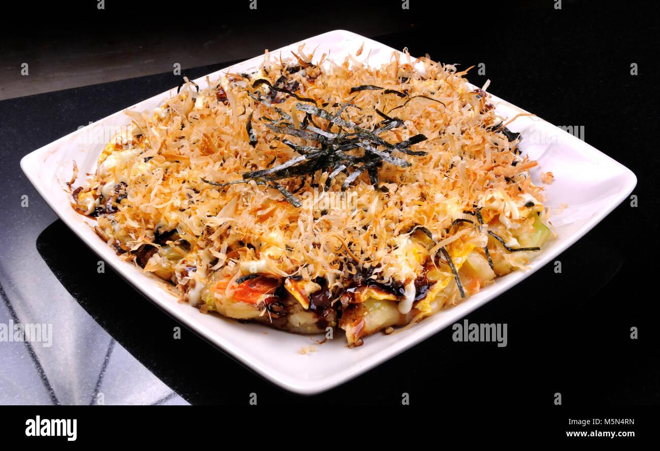 Japanese Okonomiyaki is japanese pizza great and yammy Stock Photo