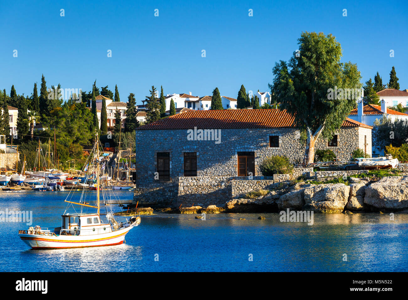 View of traditional architecture in harbour of Spetses village, Greece. - Stock Image