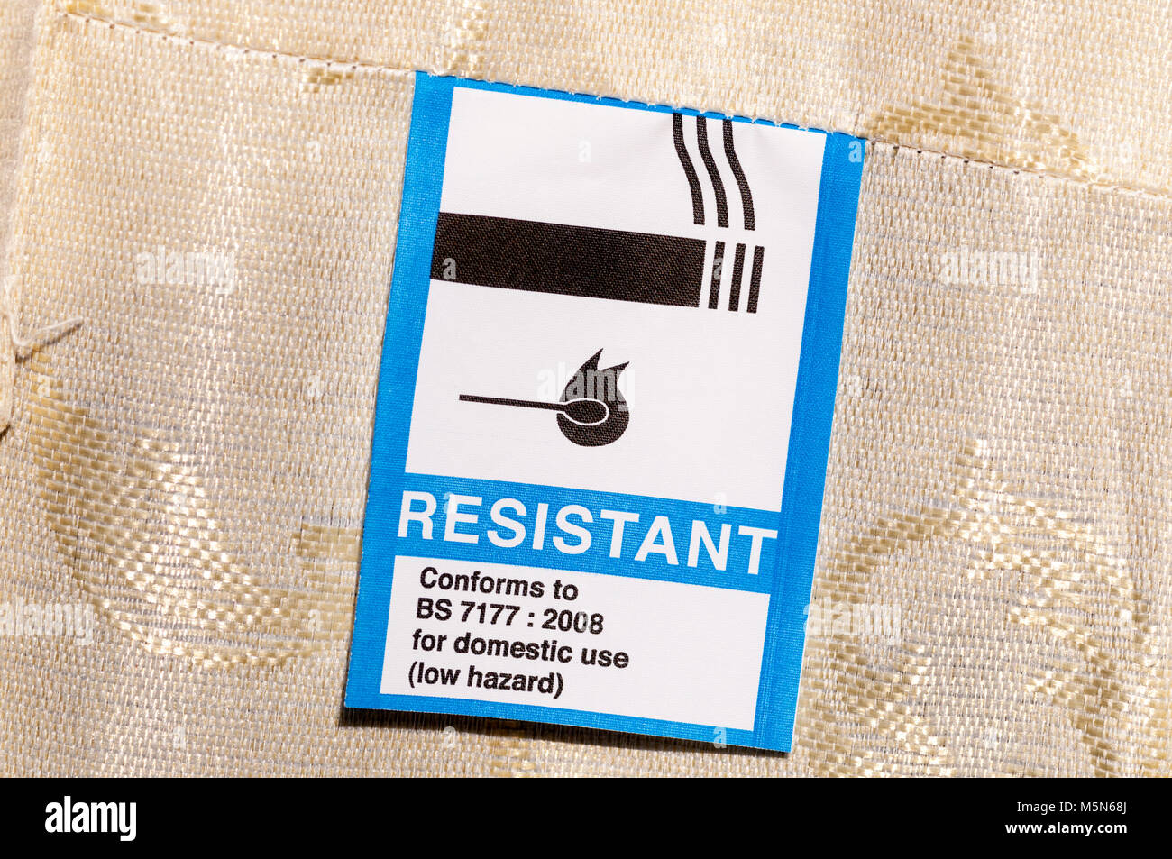 A label on a mattress confirms that it meets fire resistance standards. - Stock Image