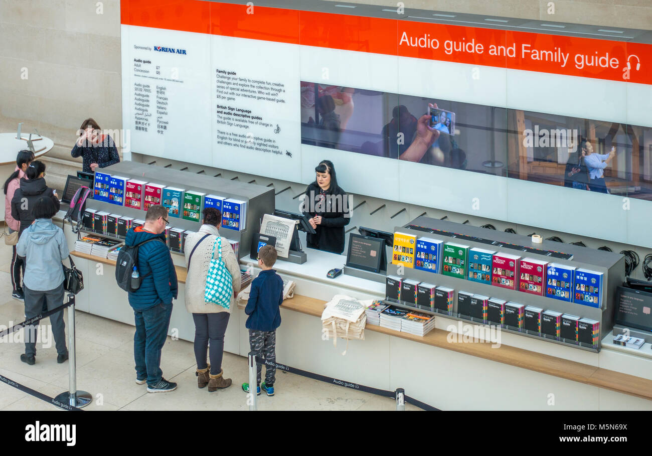 Visitor reception for hire of an audio guide and family guide. The British Museum (dedicated to human history, art - Stock Image