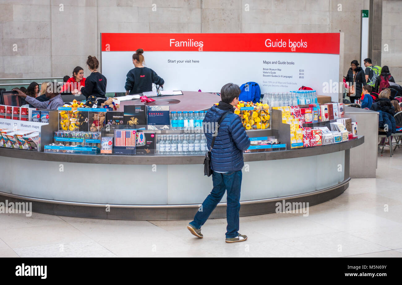 Visitor reception area, with staff attending to a customer at The British Museum (dedicated to human history, art - Stock Image