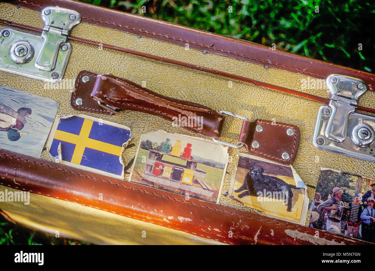 Suitcase with labels - Stock Image