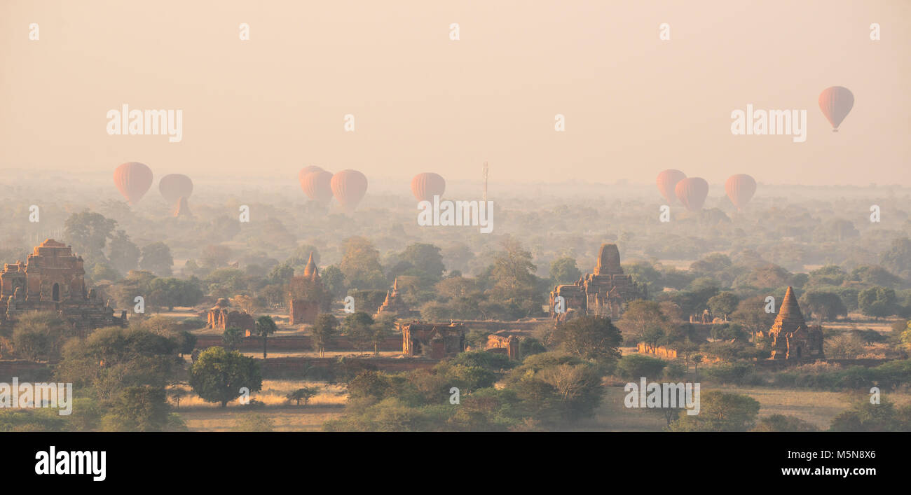Foggy hazy sunrise amid temples and pagodas in Bagan ancient historical zone, Burma - Stock Image