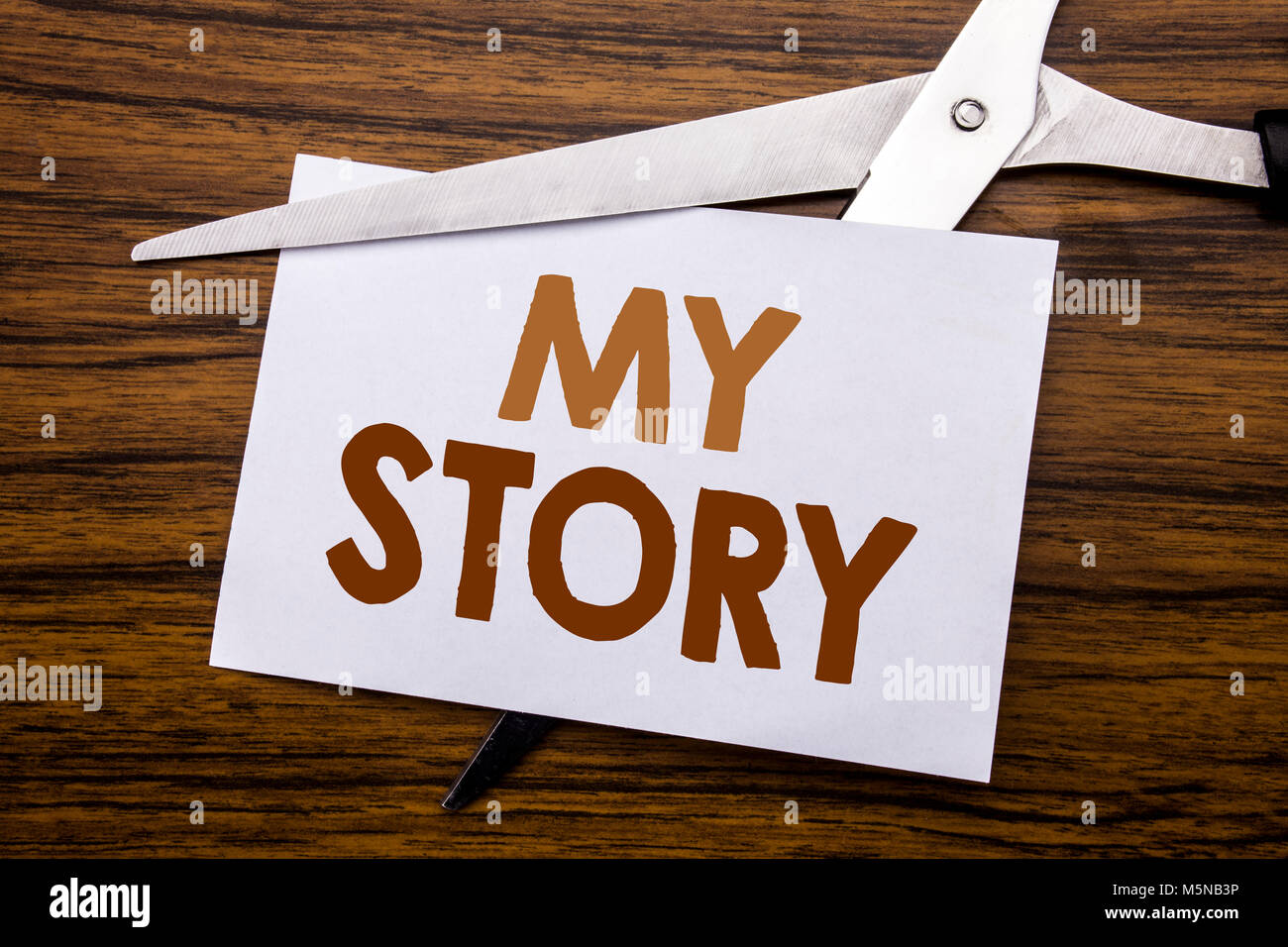 Hand writing text caption inspiration showing My Story. Business concept for Telling Tell About You Written on note, - Stock Image