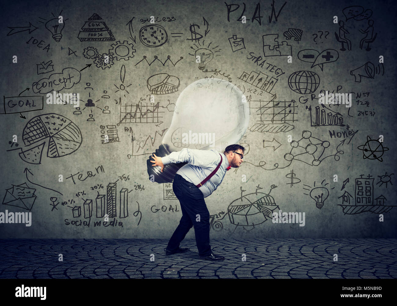 Chubby business man carrying business idea in the form of bright light bulb - Stock Image