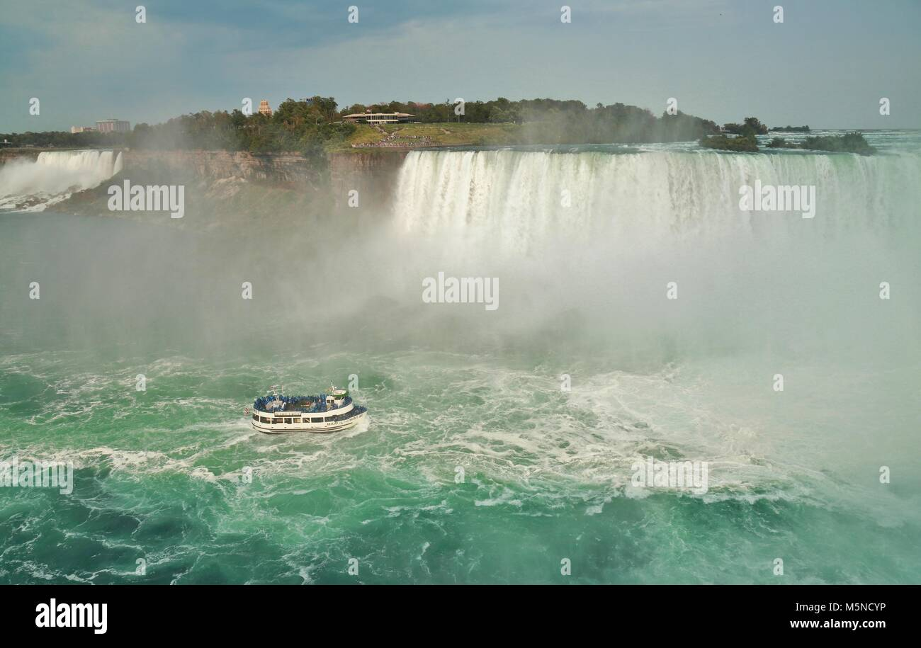 A pleasure boat at Horseshoe Falls, Niagara Falls Ontario - Stock Image