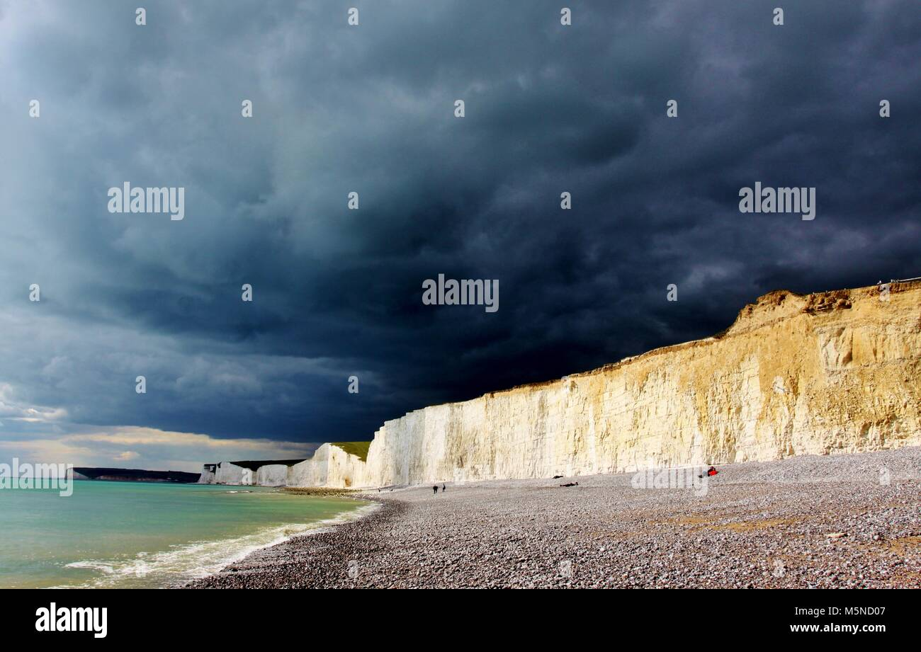 Dramatic stormy skies over the famous chalk cliffs at Birling Gap in the South Downs National Park Stock Photo