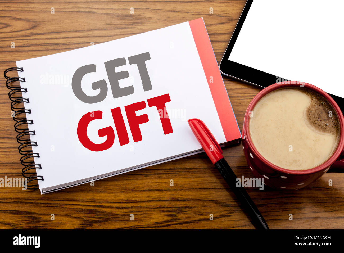 Handwriting Announcement text showing Get Gift. Business concept for Free Shoping Coupon Written on notepad paper - Stock Image