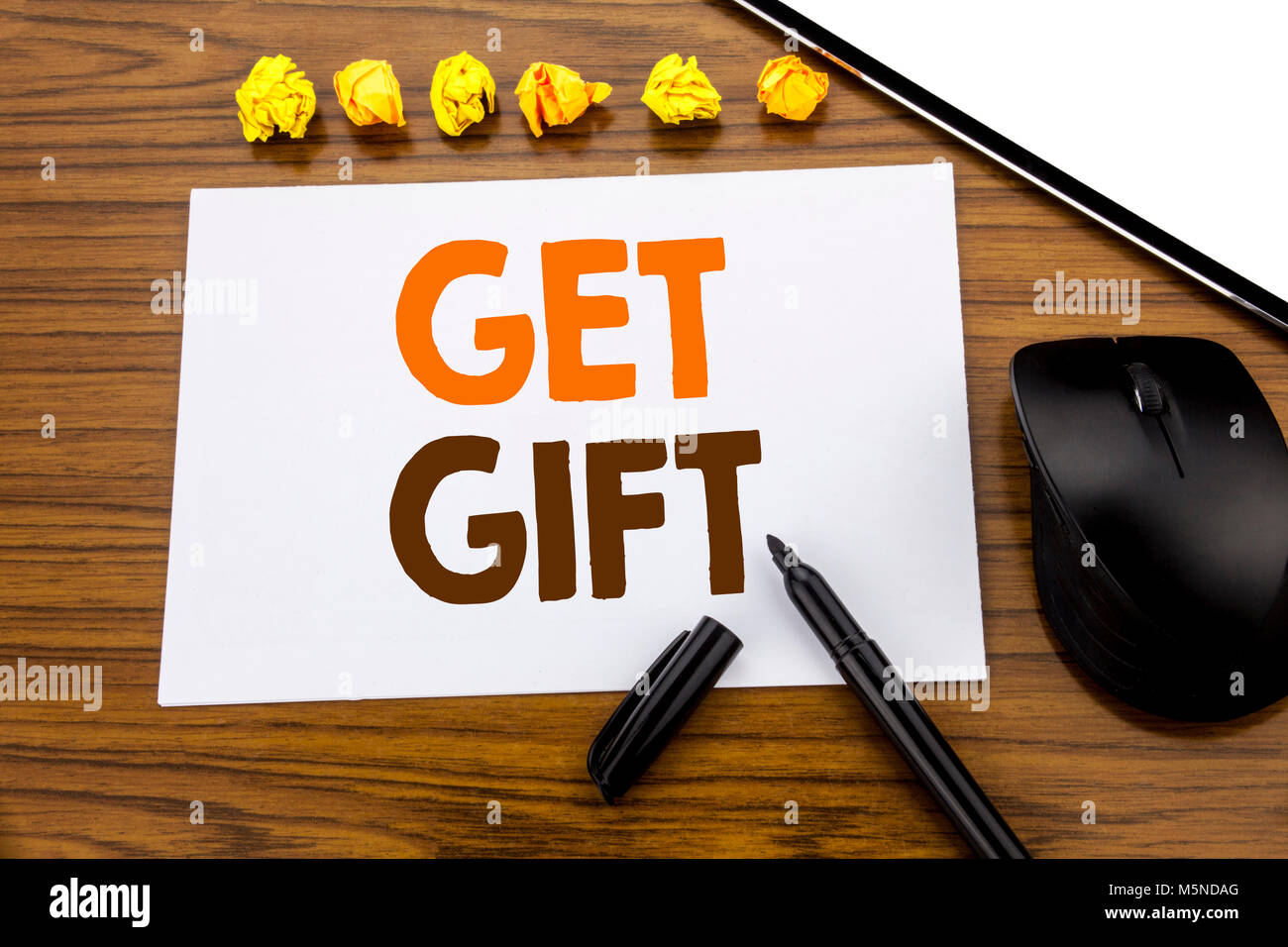 Conceptual hand writing text showing Get Gift. Business concept for Free Shoping Coupon written on sticky note paper - Stock Image