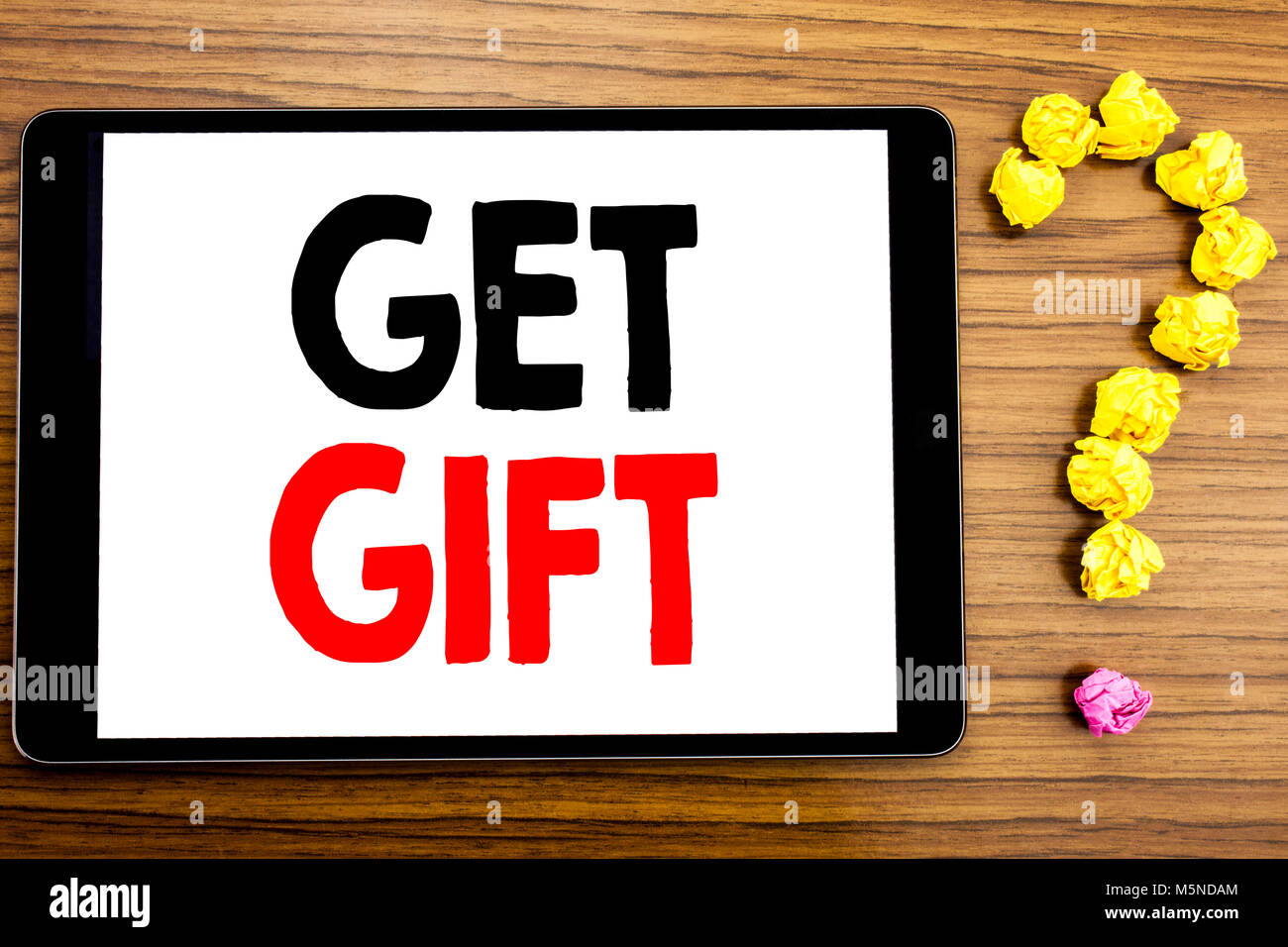 Writing text showing Get Gift. Business concept for Free Shoping Coupon written on tablet computer on wooden background - Stock Image