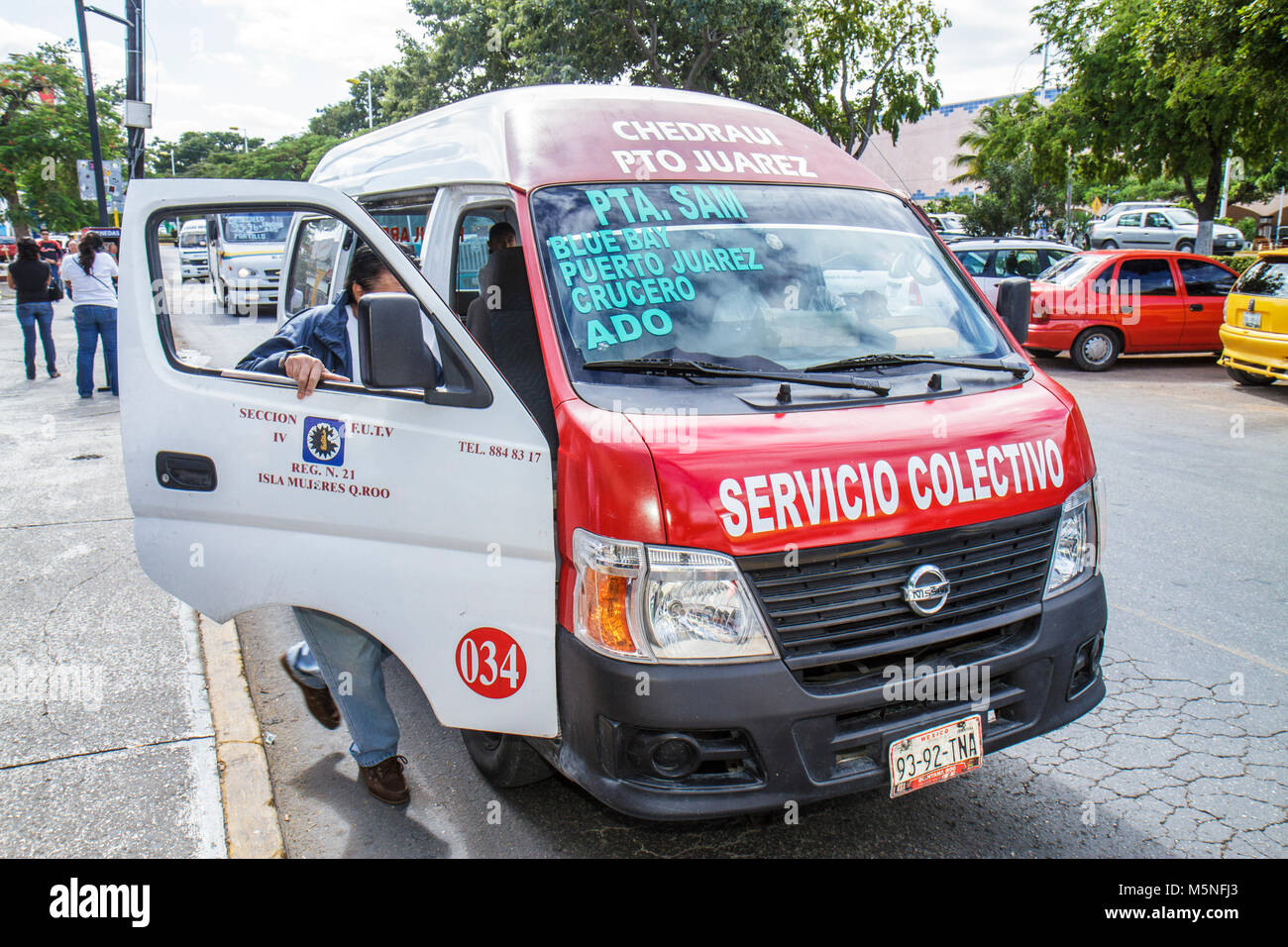 Cancun Mexico Yucatán Peninsula Quintana Roo Avenida Tulum Hispanic man bus van transportation colectivo share taxi Stock Photo