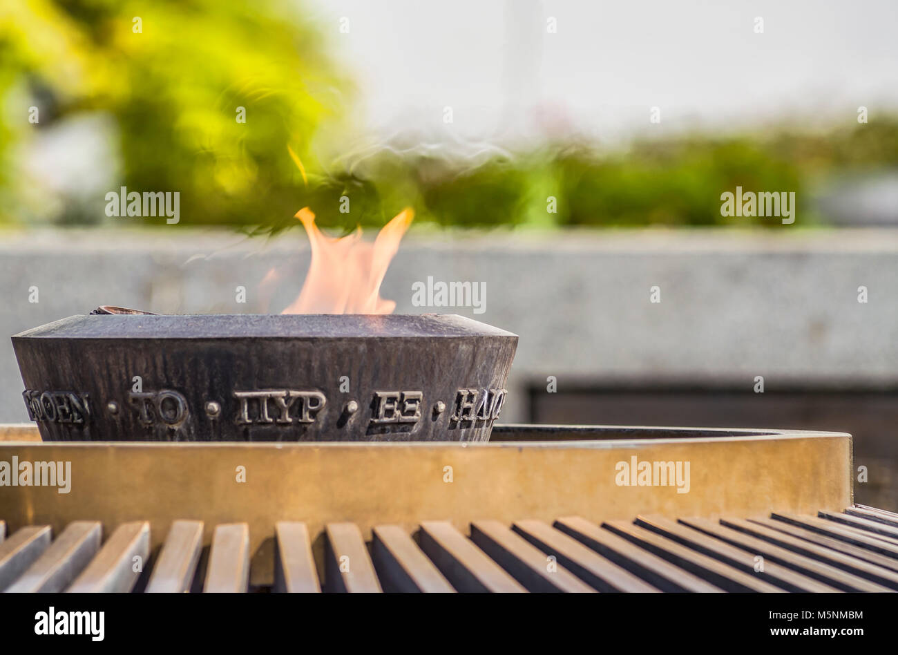 Eternal Olympic Flame at the Olympic Museum in Lausanne, Switzerland. The Olympic Museum in Lausanne, Switzerland - Stock Image