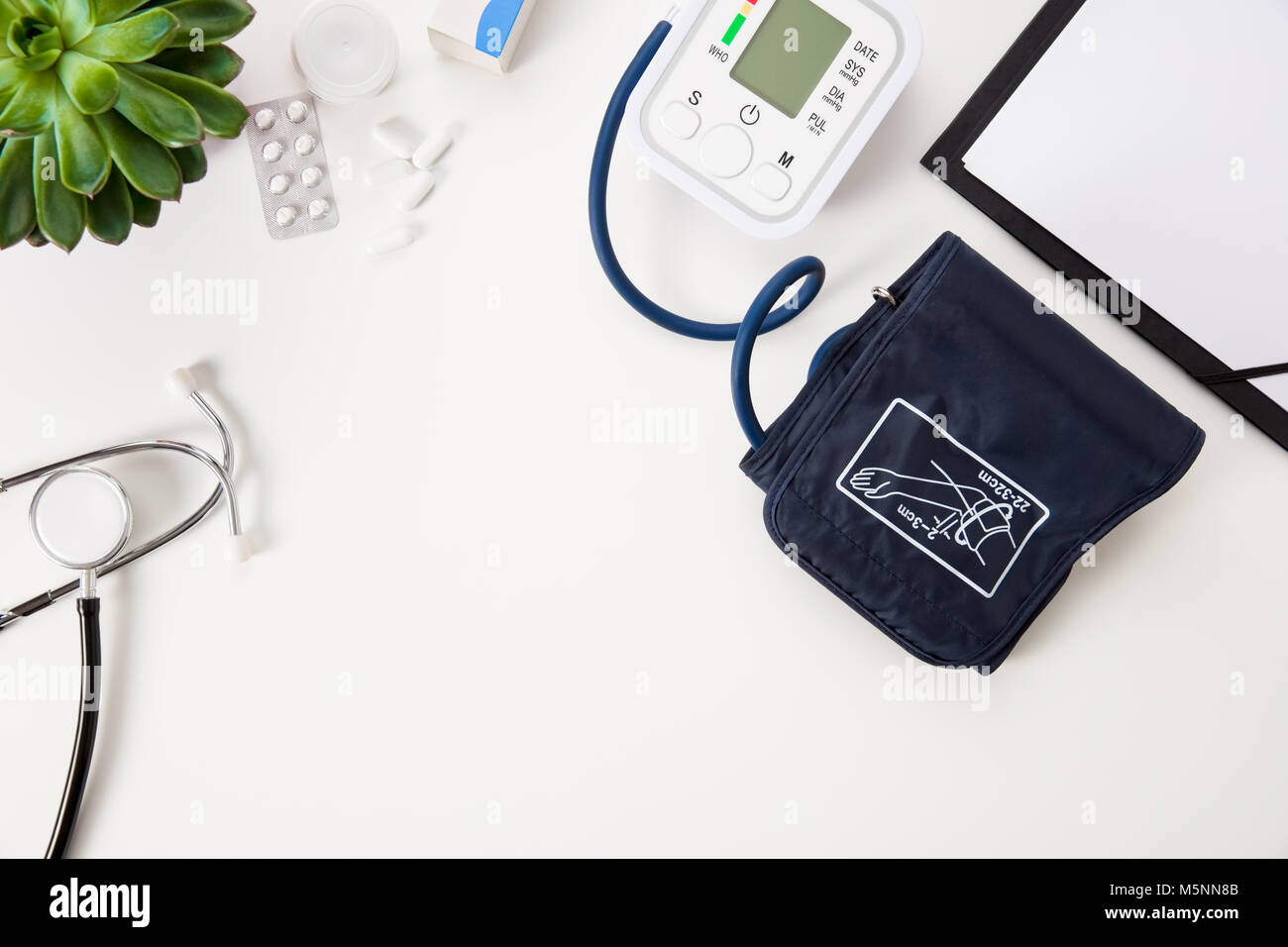 Blood Pressure Machine With Stethoscope And Clipboard On White T - Stock Image
