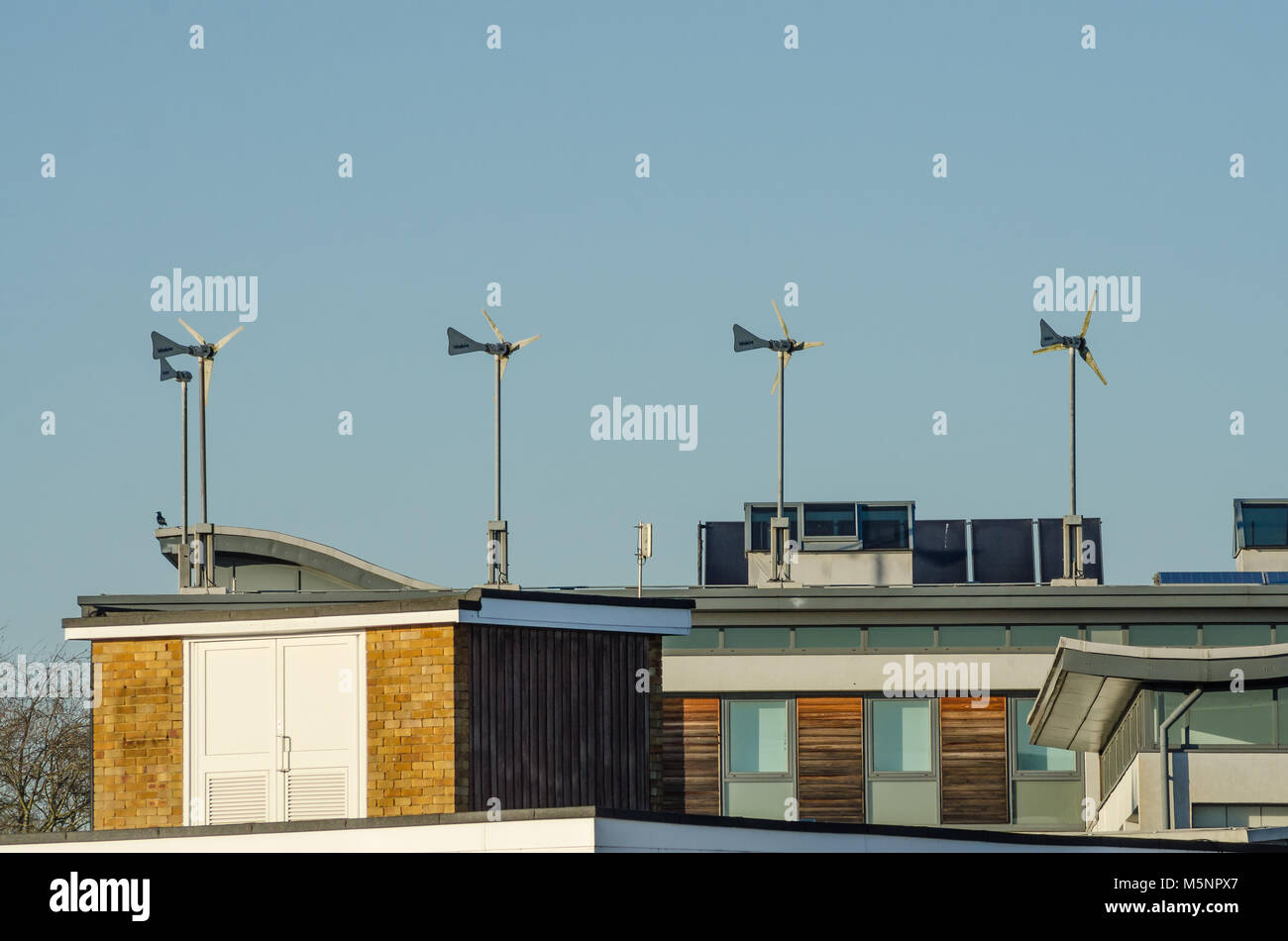 Small Wind Turbines On The Roof Of A Building Generate Electricity To Power  The Building