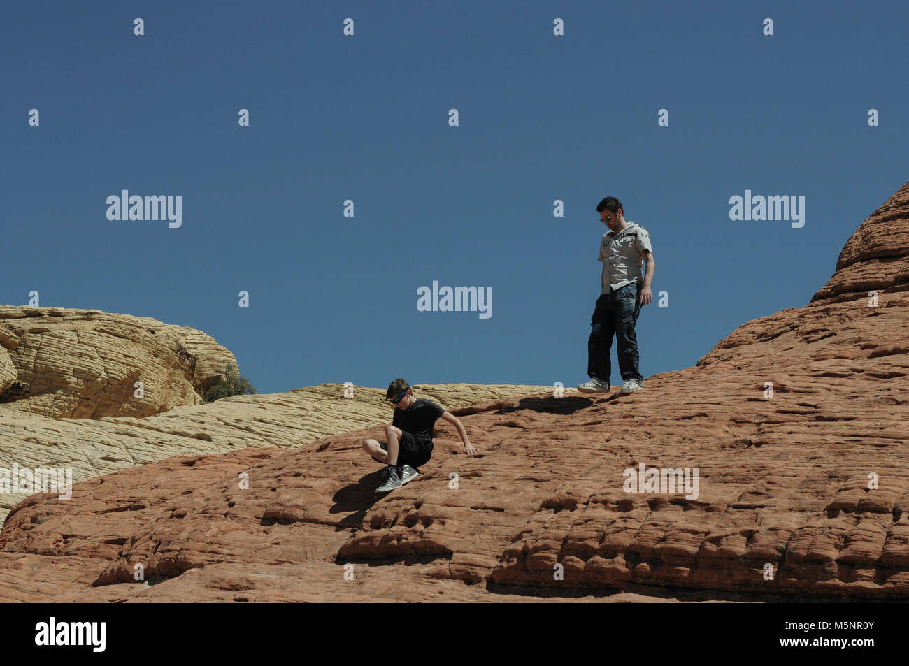People hiking in Red Rock Canyon, Nevada, USA on a bright sunny day Stock Photo