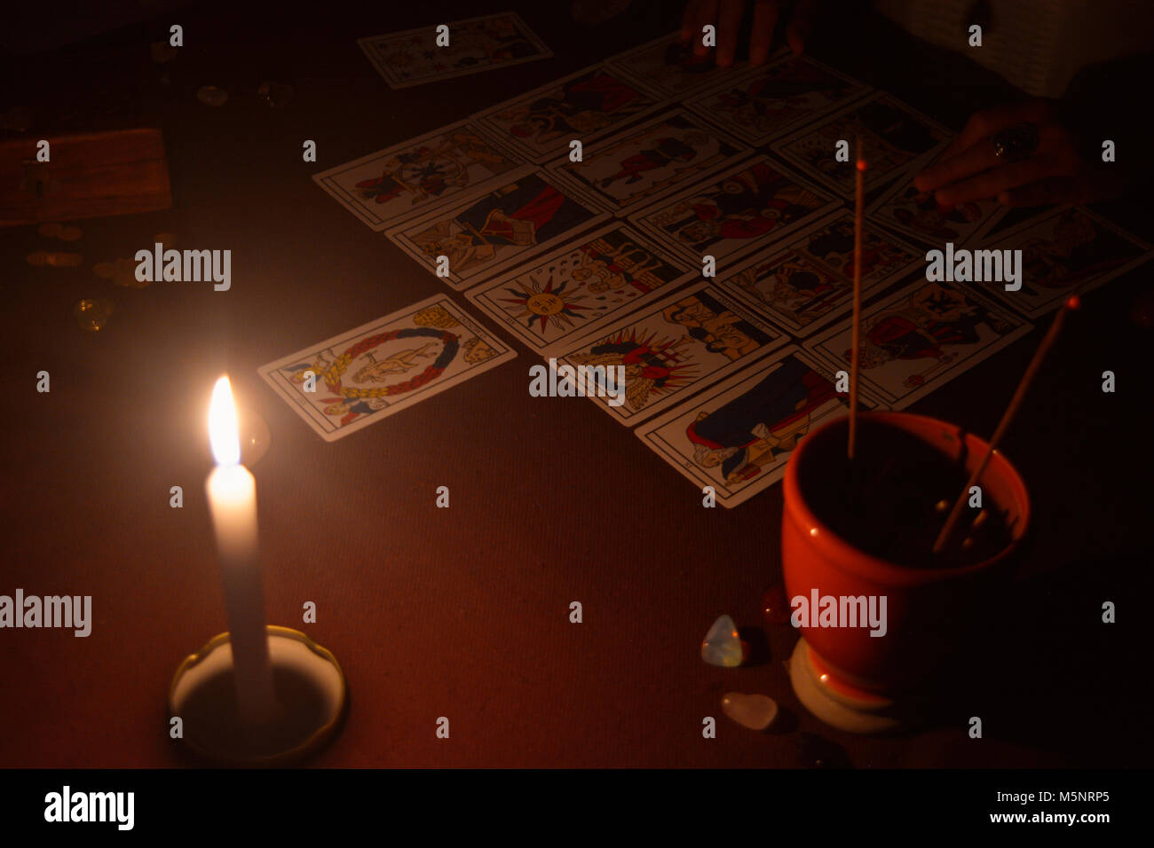 Tarot table by candle light - Stock Image