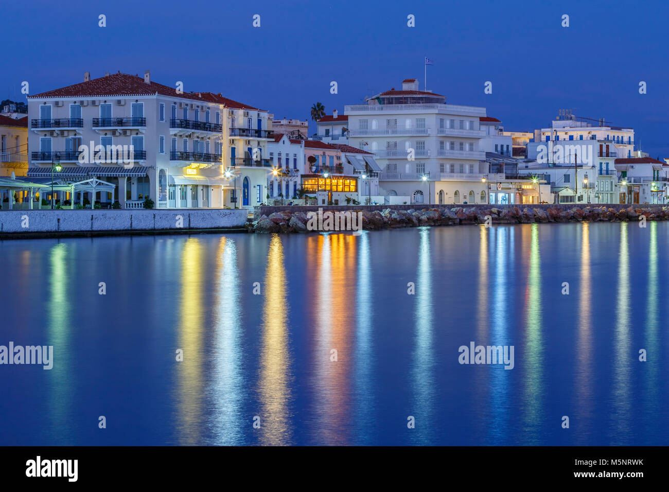 Morning view of Spetses seafront from the beach, Greece. - Stock Image