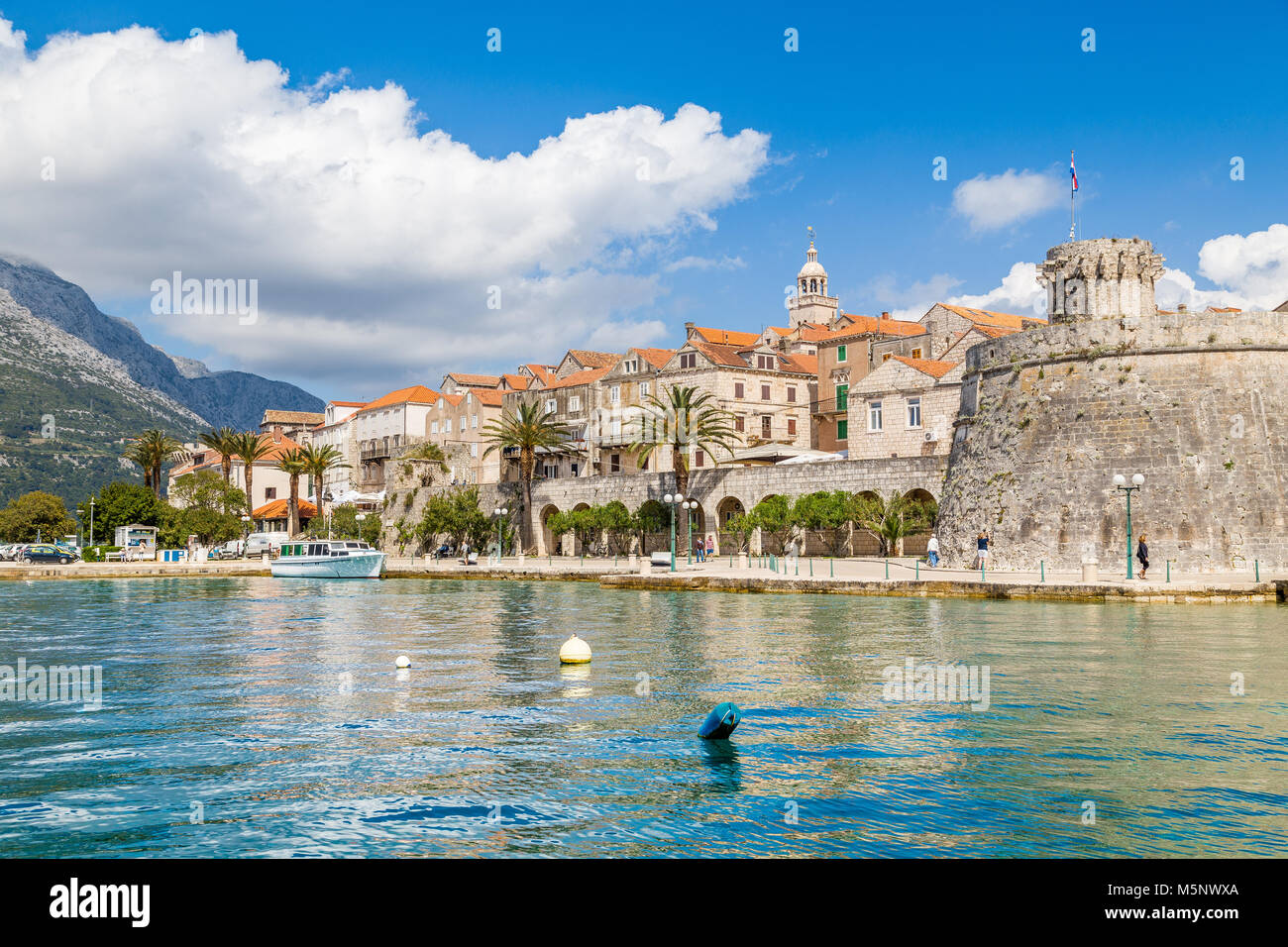 Beautiful view of the historic town of Korcula on a beautiful sunny day with blue sky and clouds in summer, Island - Stock Image