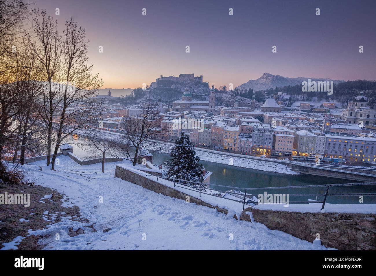 Classic panoramic view of the historic city of Salzburg with Salzach river in beautiful early morning light at sunrise Stock Photo