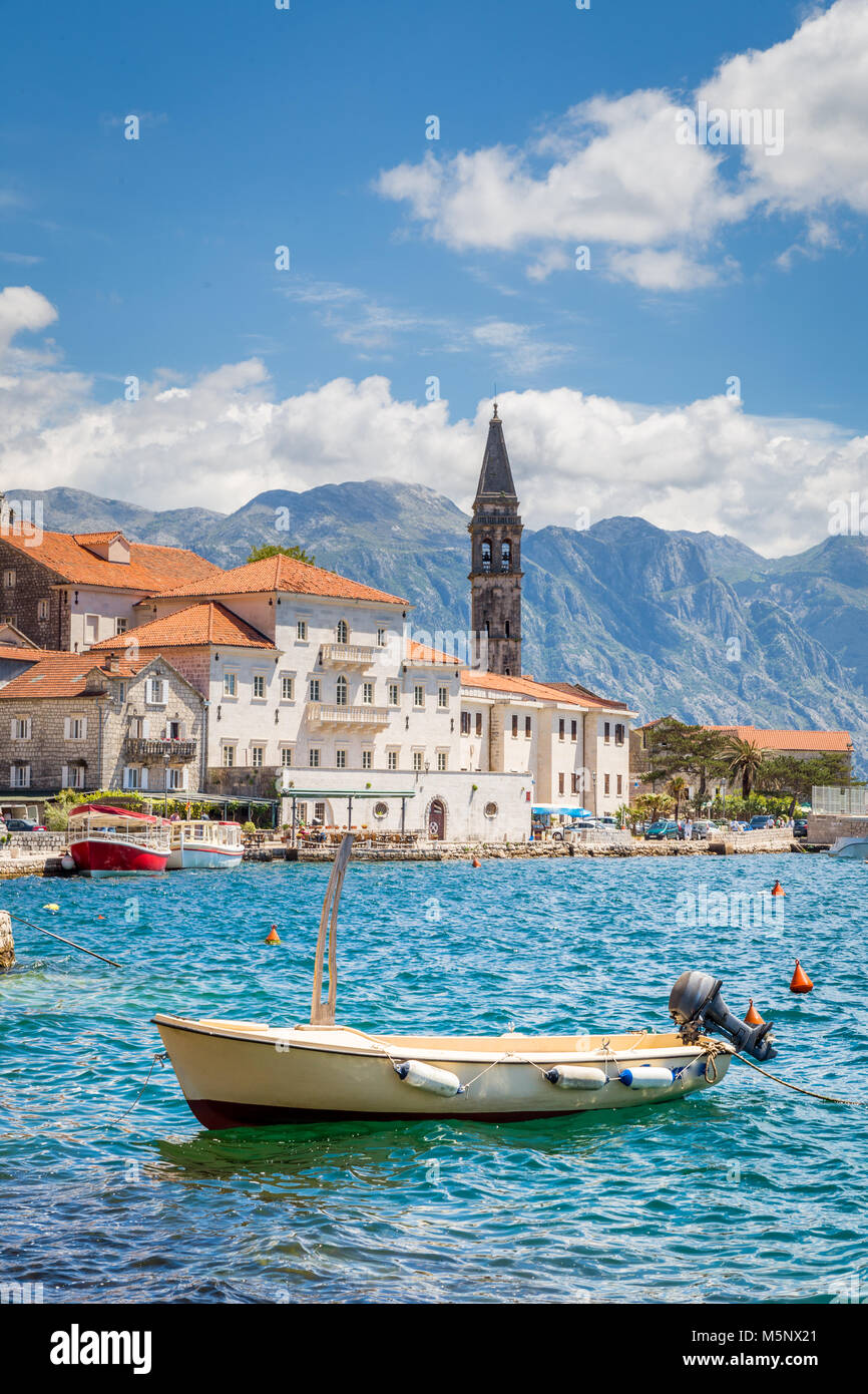 Historic town of Perast located at world-famous Bay of Kotor on a beautiful sunny day with blue sky and clouds in - Stock Image