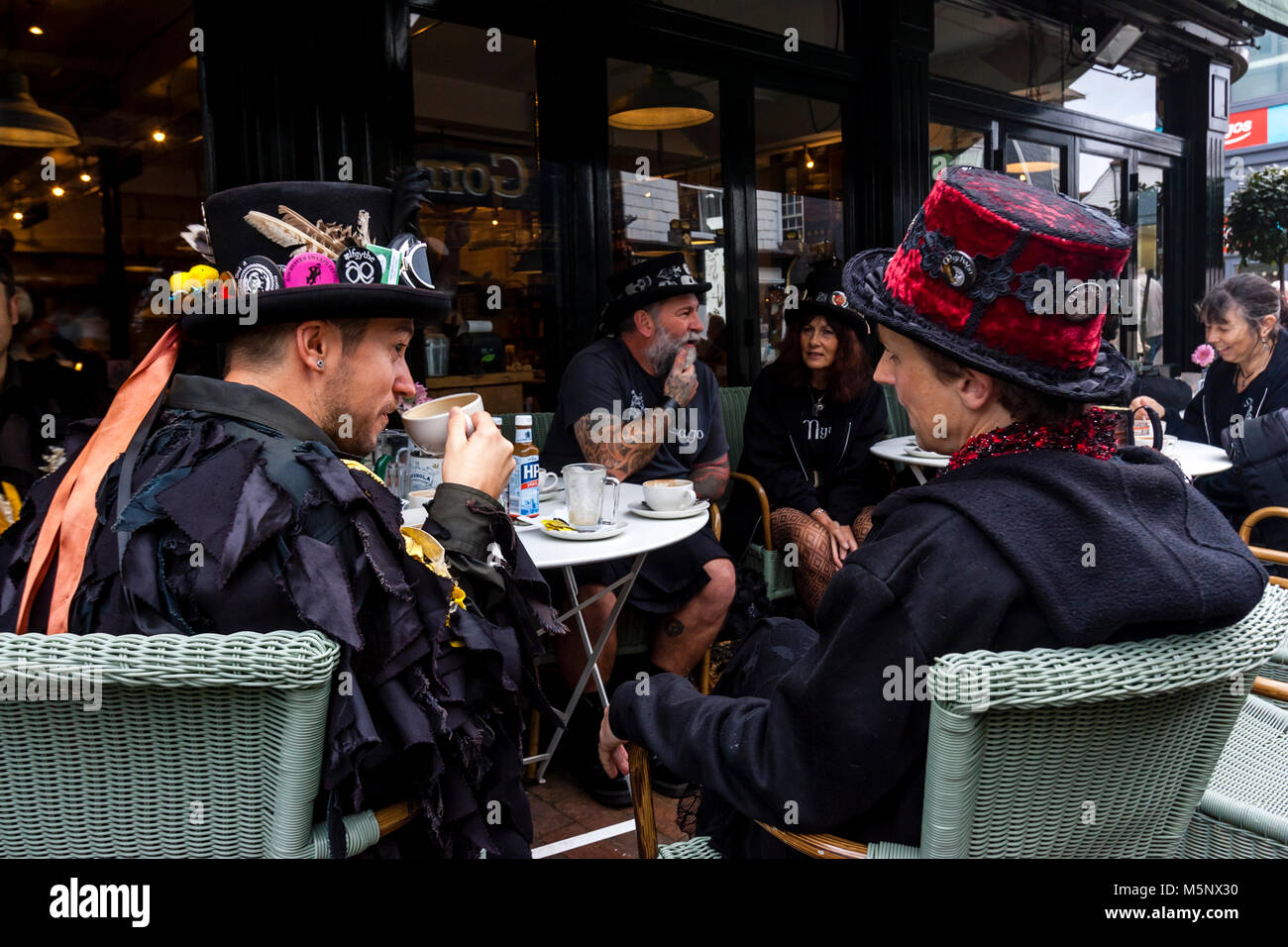 A Group Of Morris Dancers Drinking Coffee In A Cafe Before Performing At The Annual Lewes Folk Festival, Lewes, - Stock Image