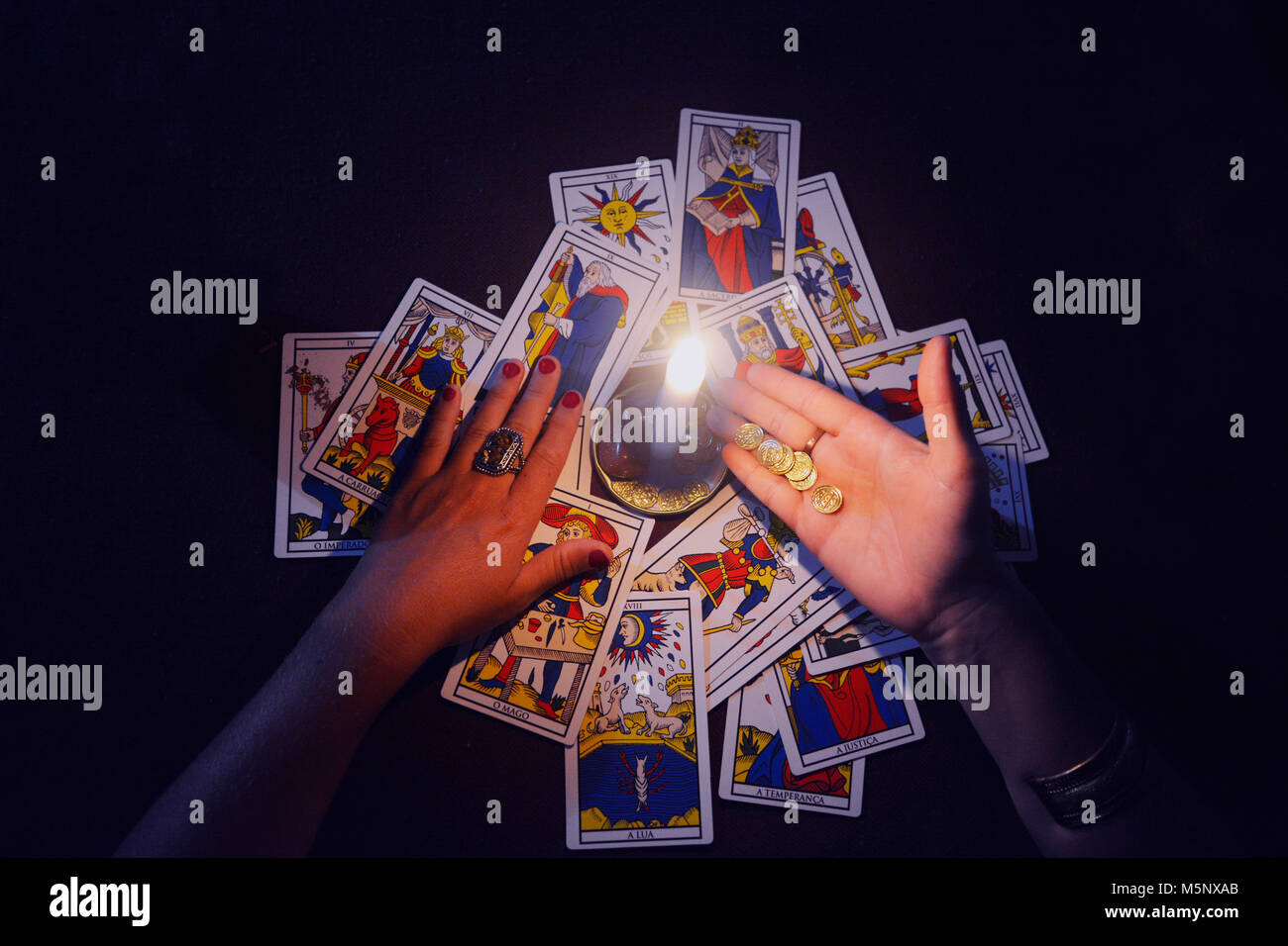 Tarot Cards and candle on table - Stock Image