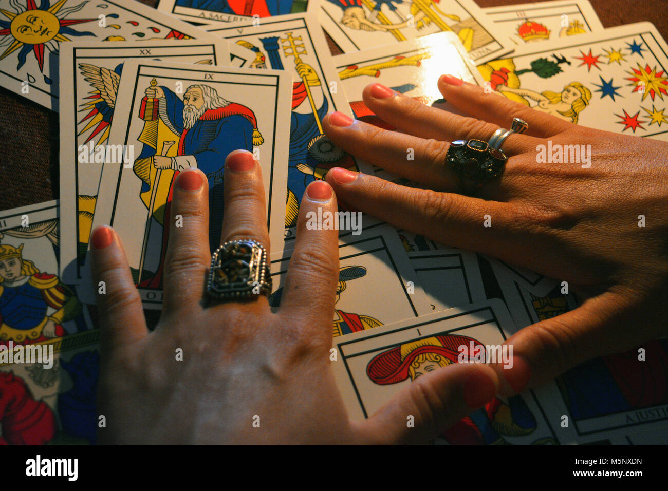 Tarot table and hands - Stock Image