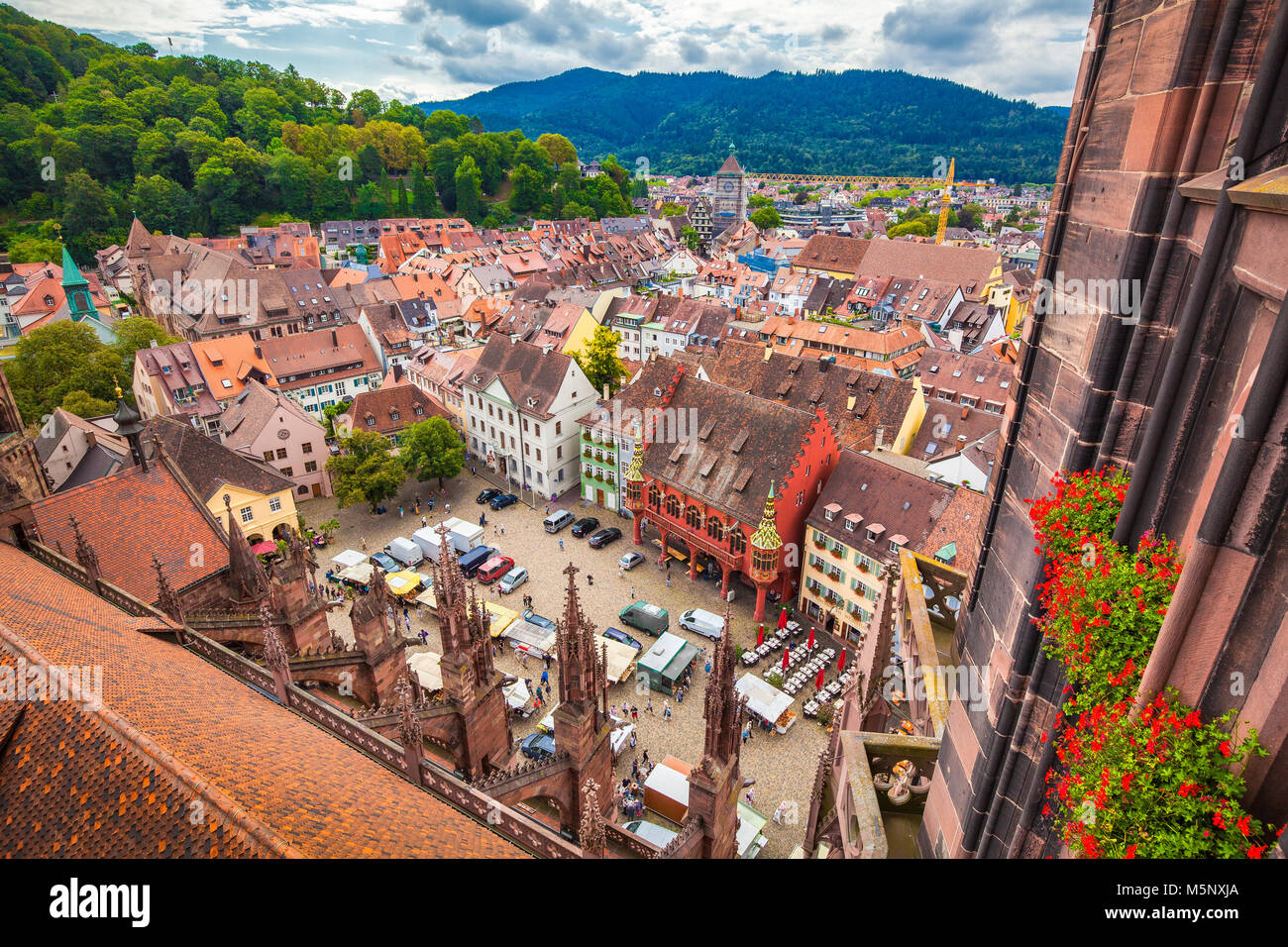 Aerial view of the historic city center of Freiburg im Breisgau from famous Freiburger Minster in beautiful evening - Stock Image