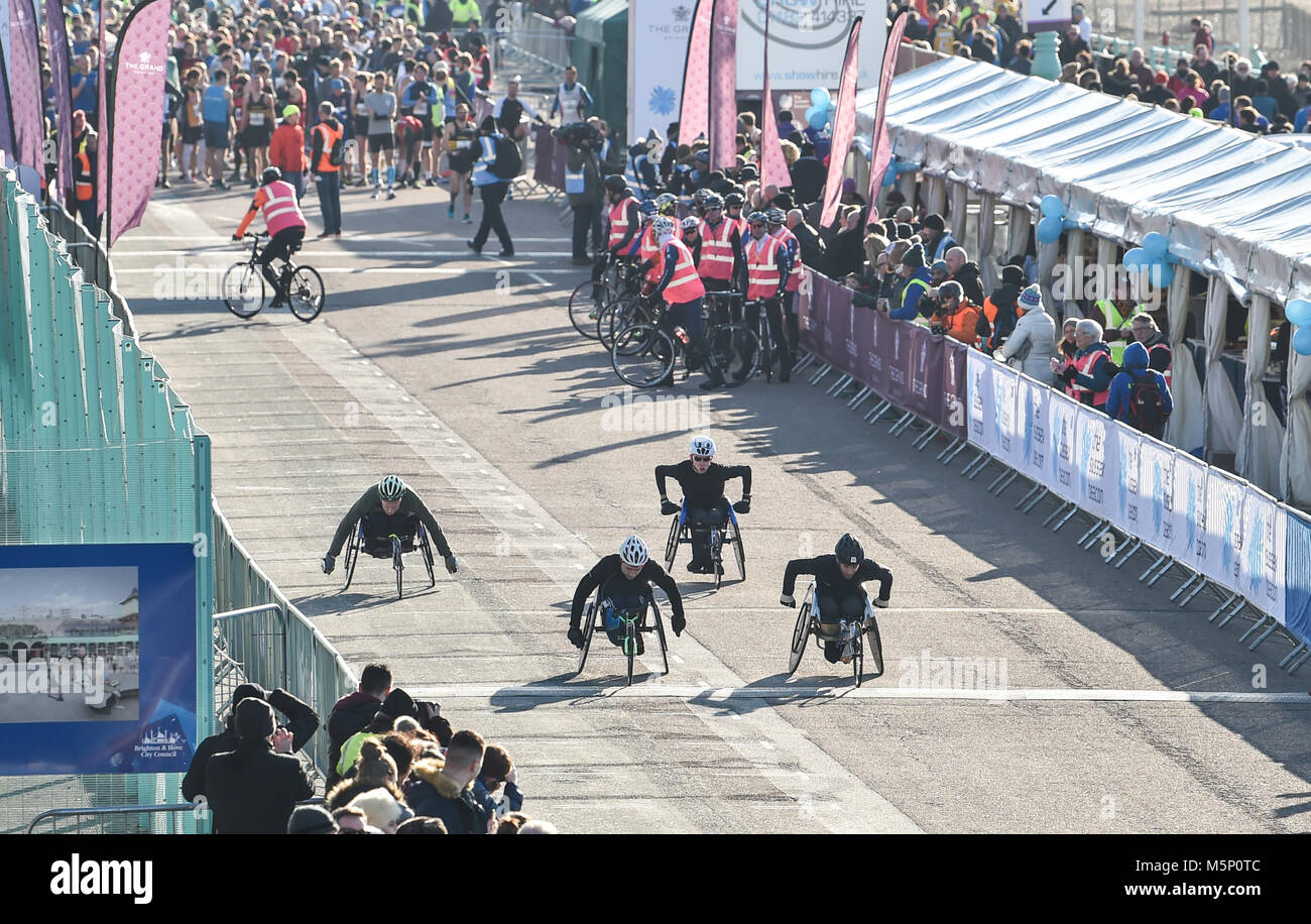 Brighton UK 25th February 2018 - The wheelchair competitors set off as thousands of runners take part in the Grand - Stock Image