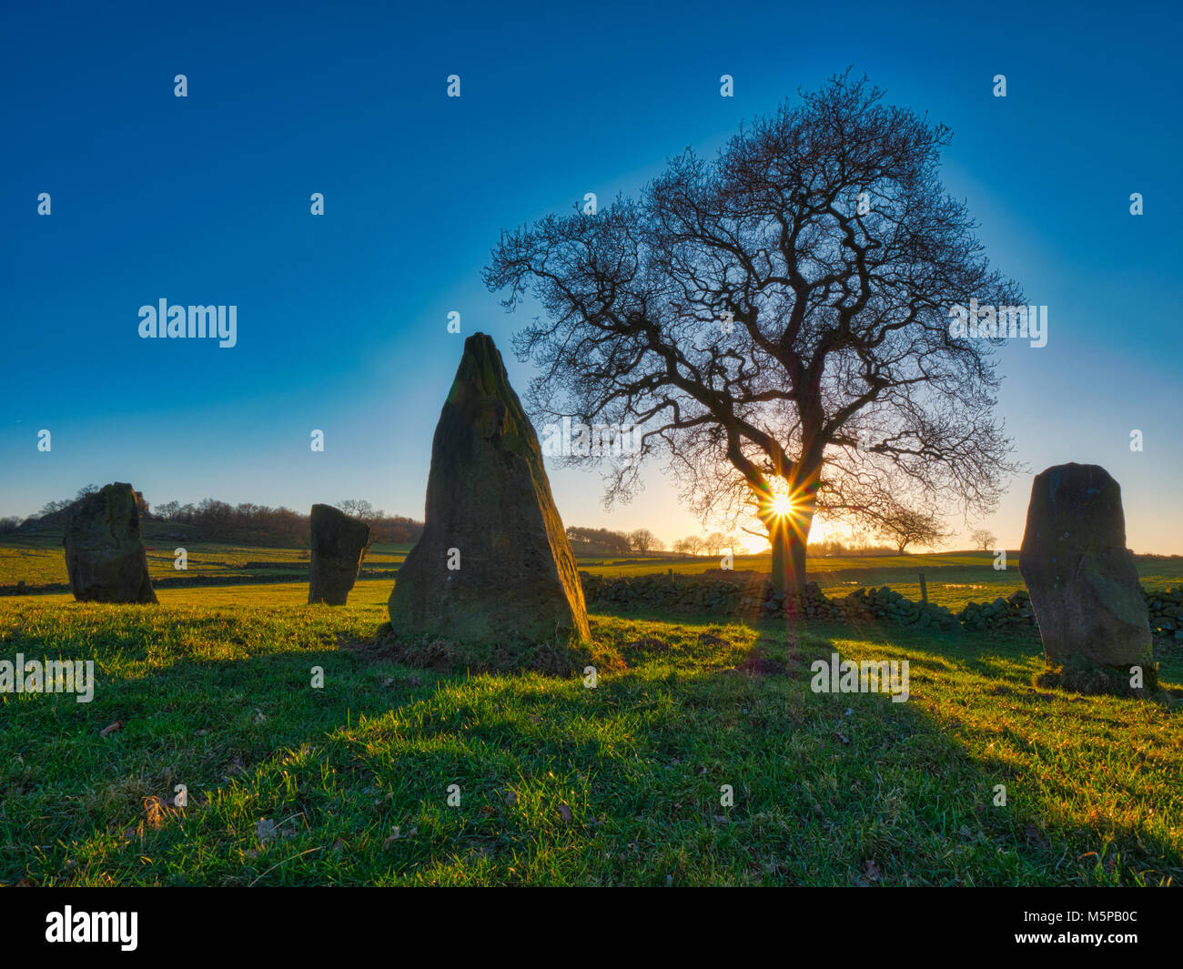 Peak District, Derbyshire, UK. 25th February, 2018. UK Weather spectacular sunset on a bitterly cold day at TheStock Photo