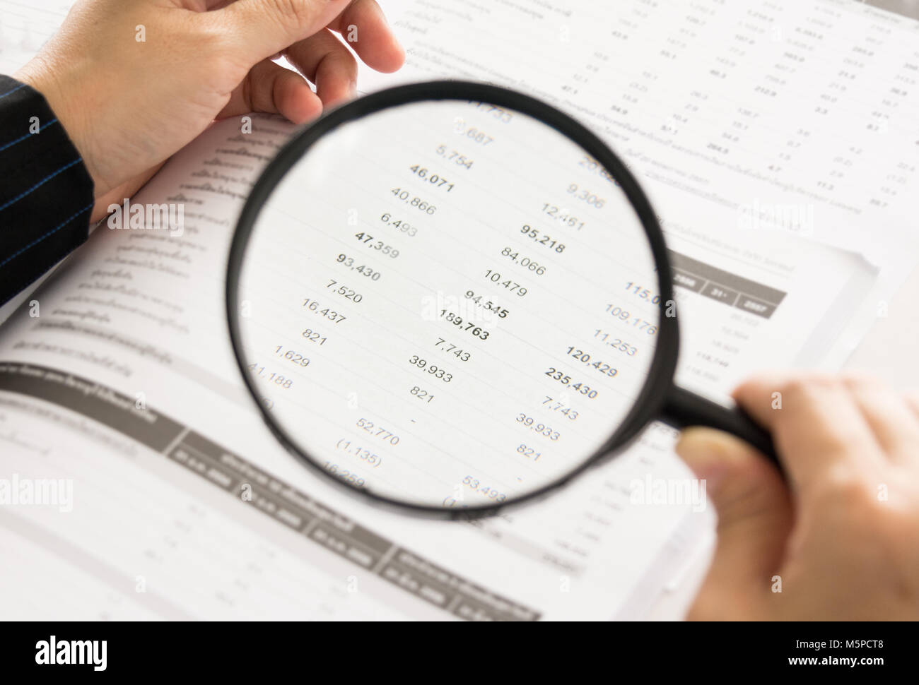 auditor or internal revenue service staff checking annual financial statements of company - Stock Image