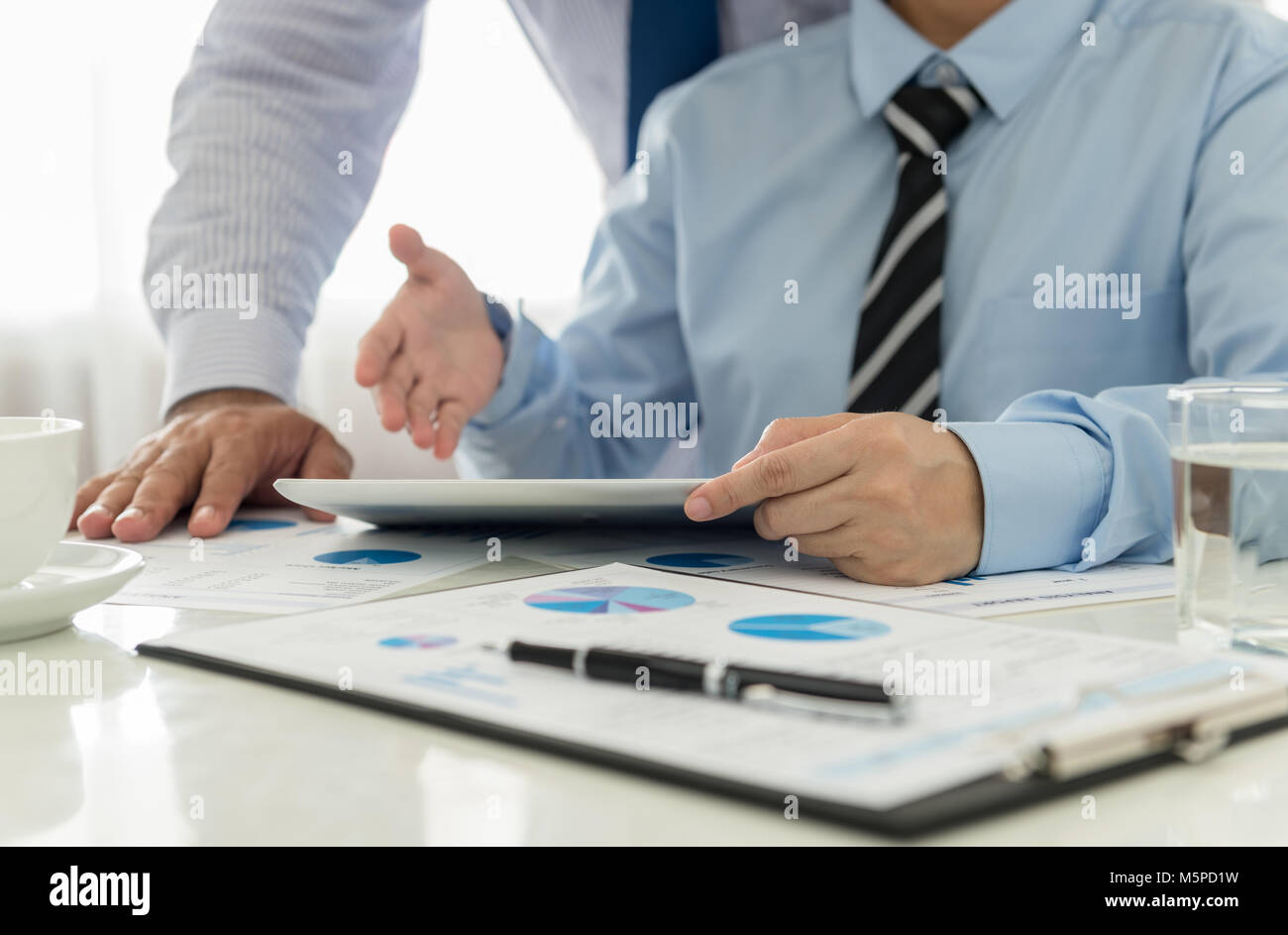 Marketing staff are analyzing the data to business planning. - Stock Image