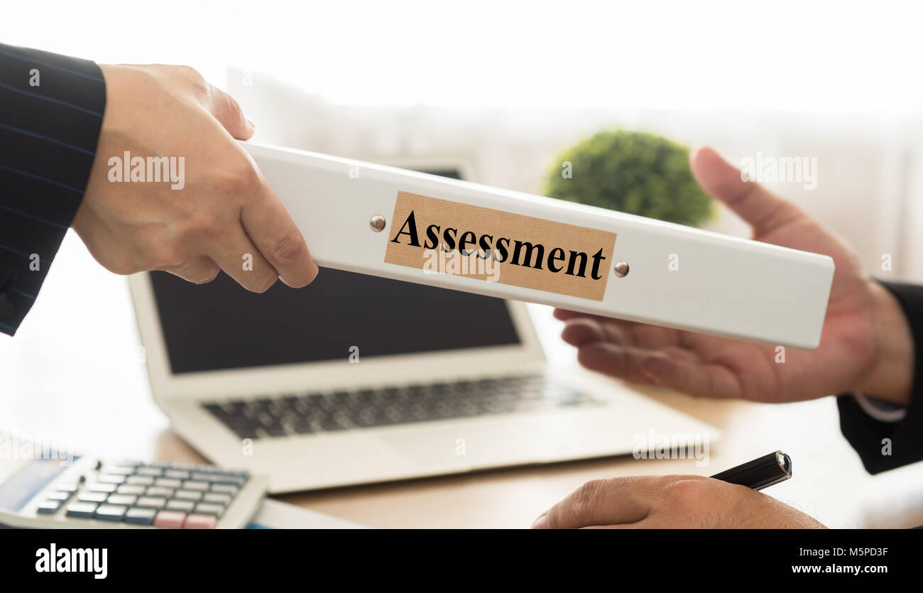 Staff send assessments summary report to the manager. selective focus. - Stock Image