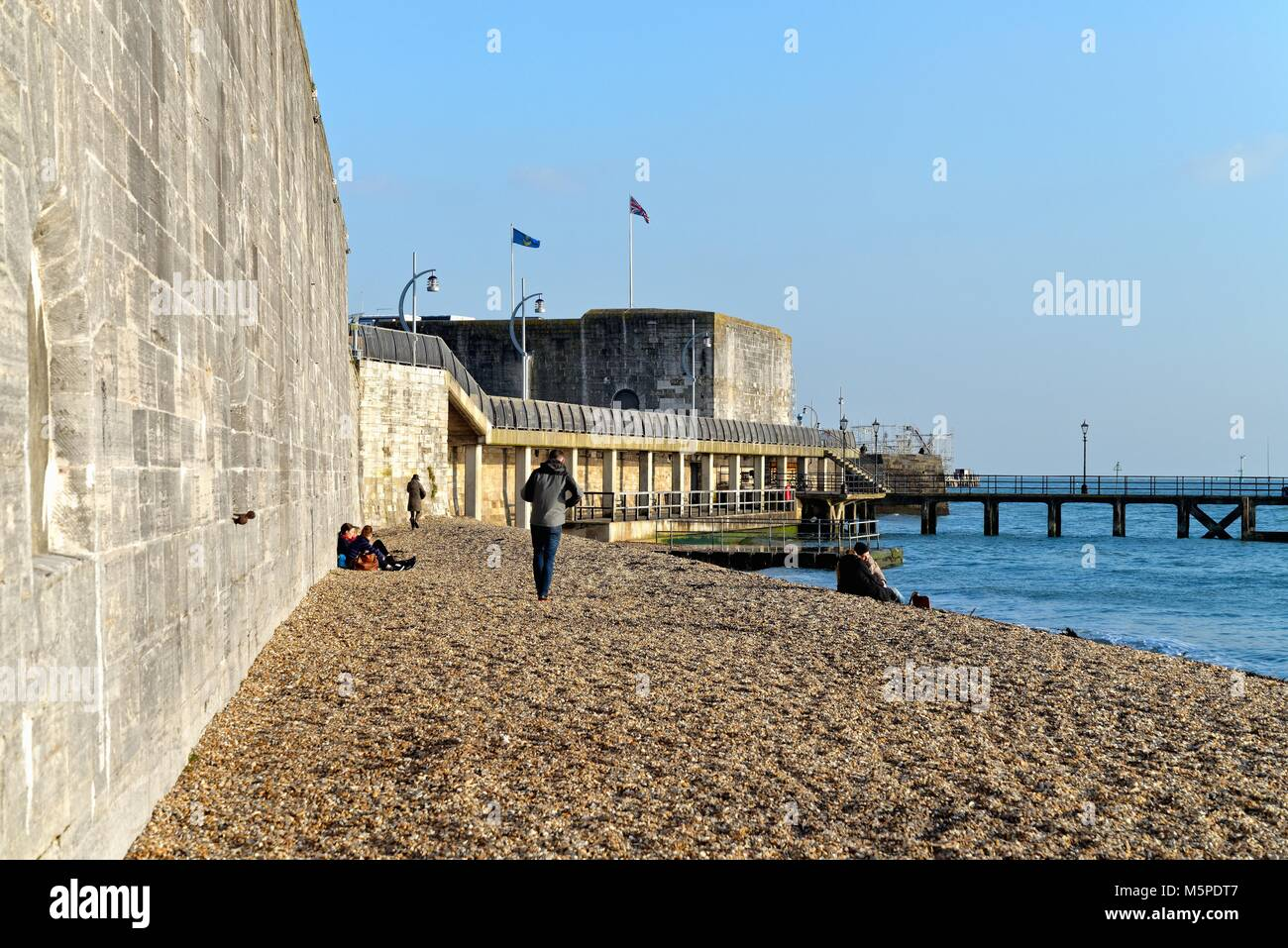 The fortifications and seawall of old Portsmouth and beach Portsmouth Hampshire England UK - Stock Image