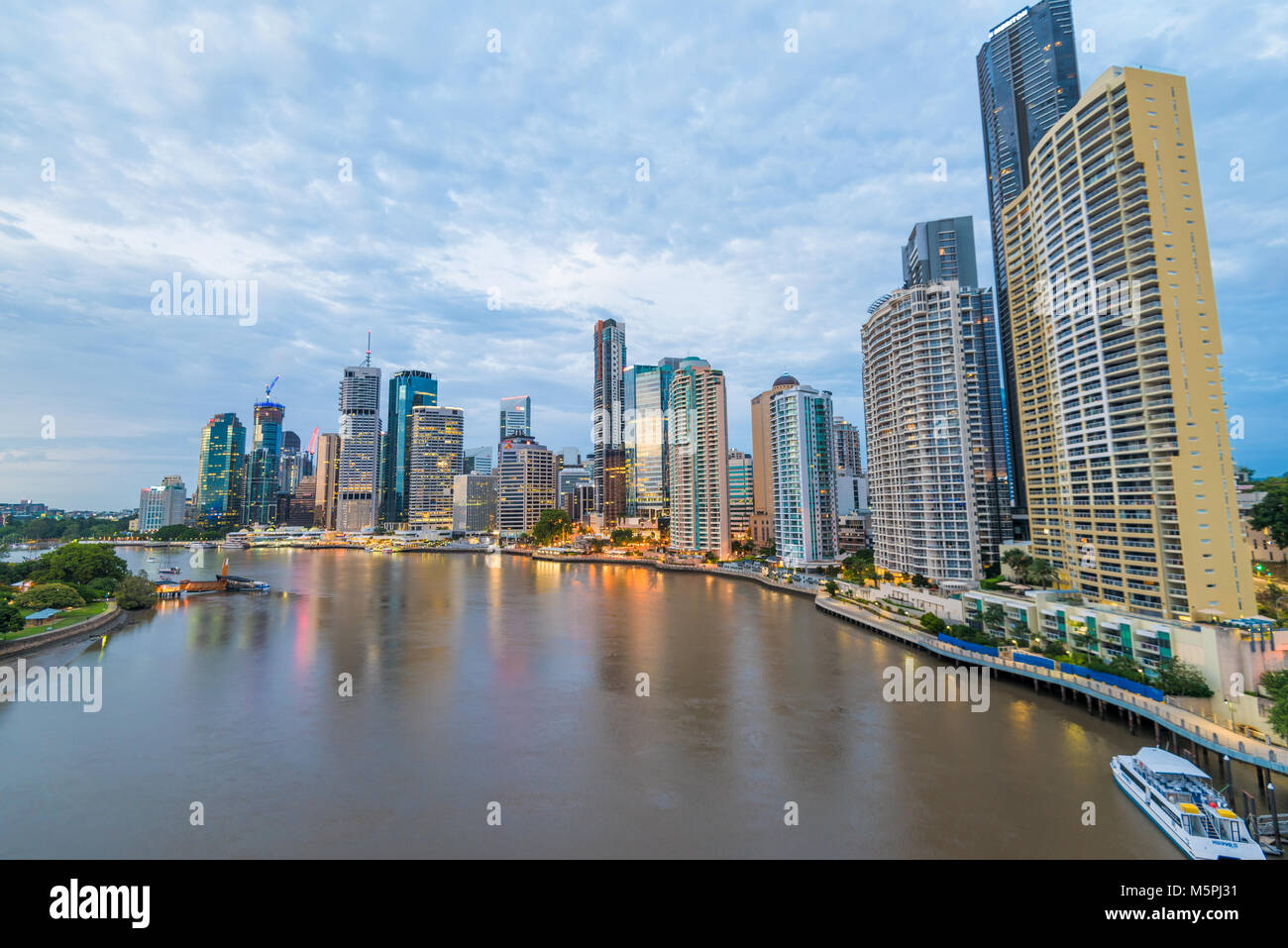 Brisbane river waterfront sunrise.  Dawn over the Central Business District area of this Australian city - Stock Image