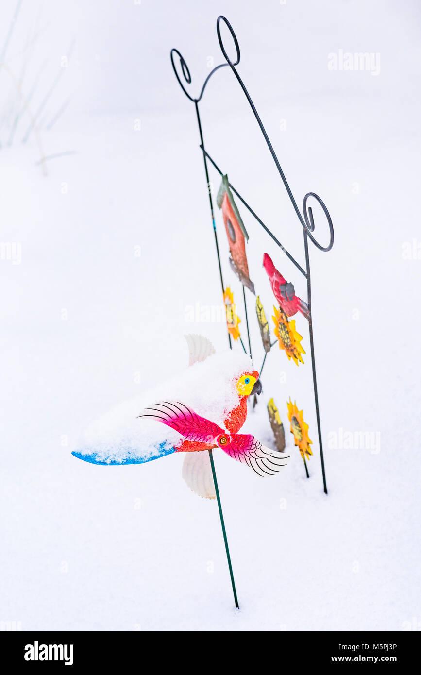 Bird Whirligig Garden Ornament Covered In Snow, Canada.