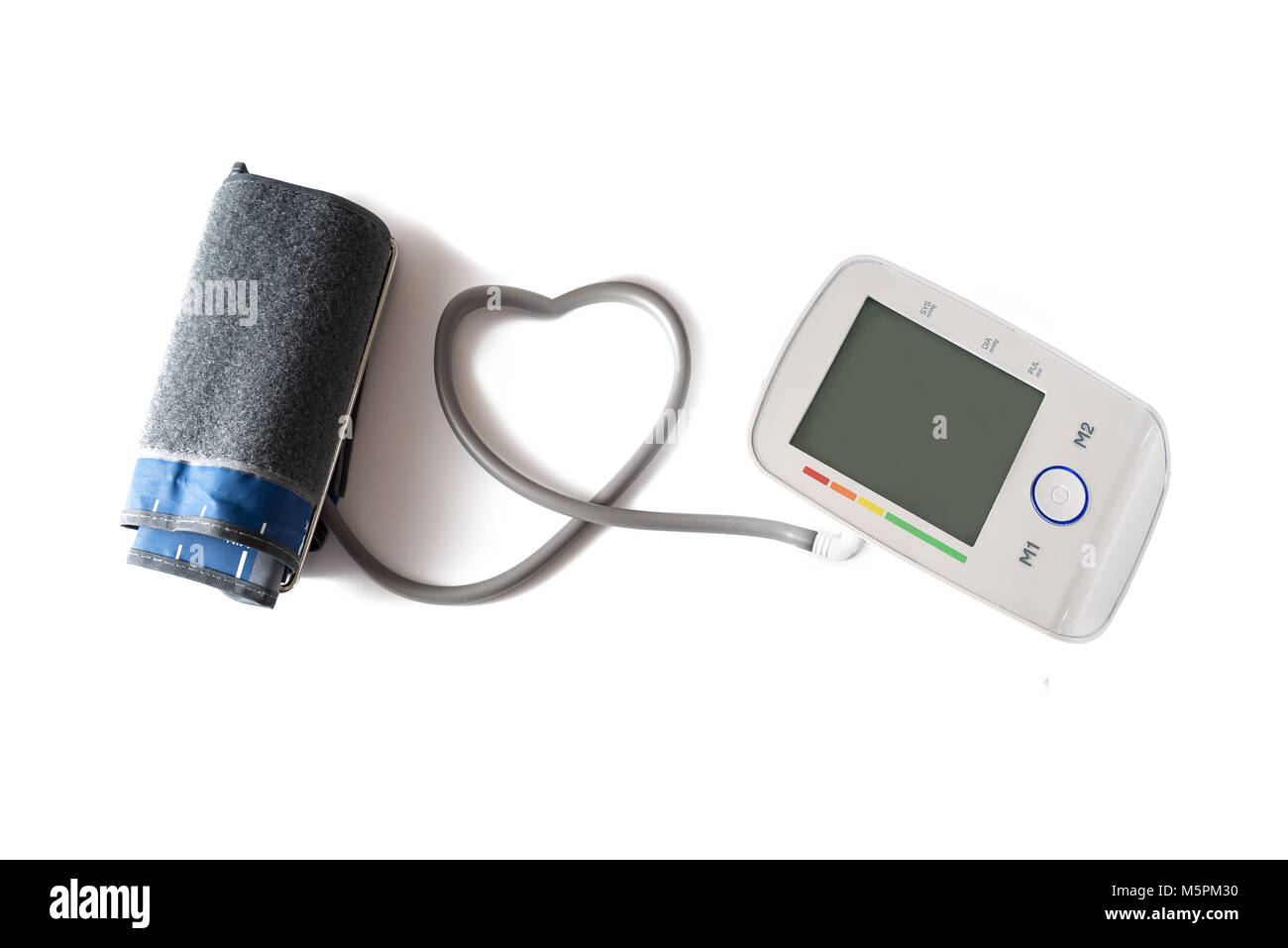 Blood pressure gauge with cuff and monitor connected with a tube in heart shape, device for health and medicine - Stock Image