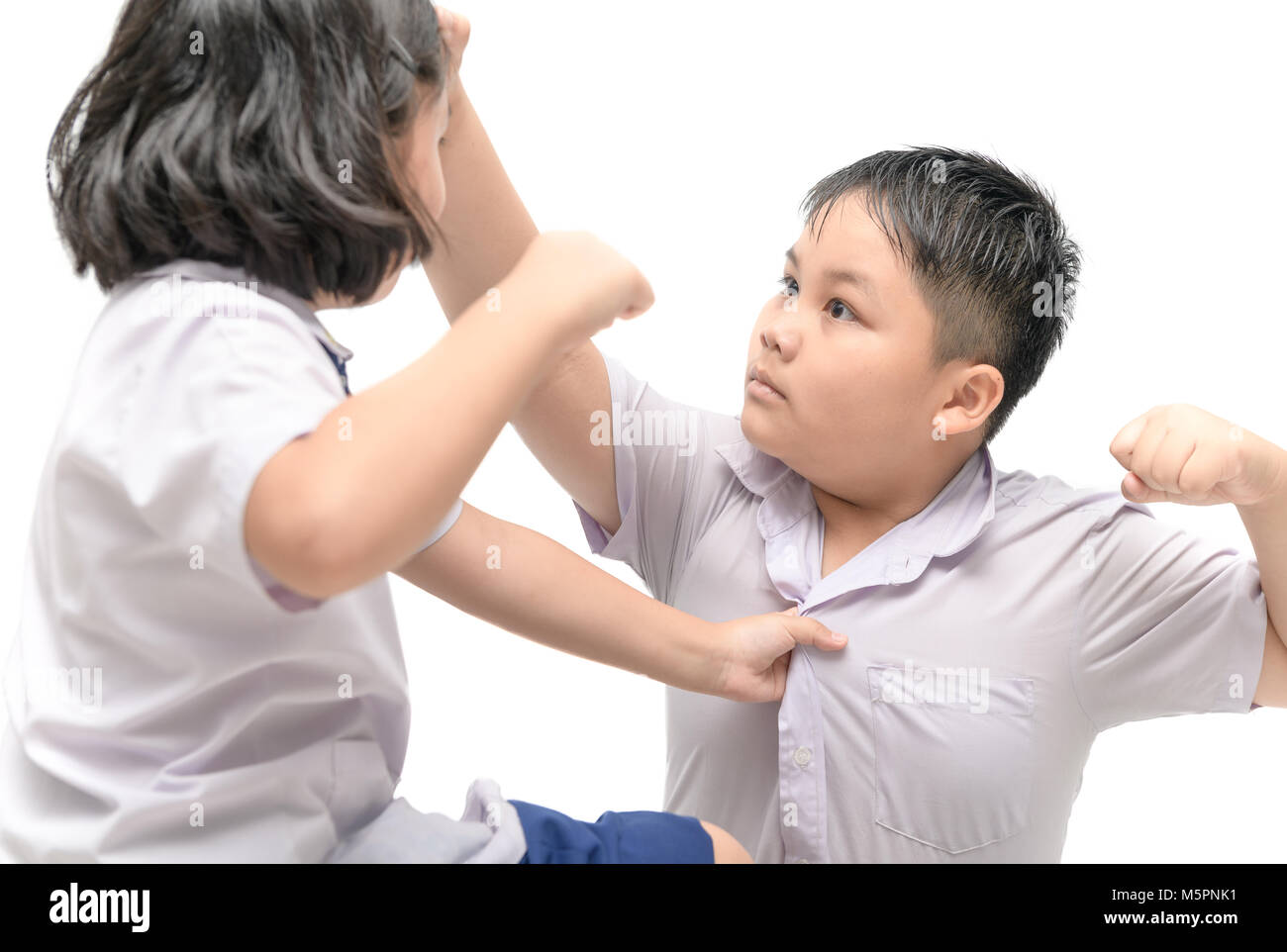 asian brother and sister quarreling isolated on white background, fighting children - Stock Image