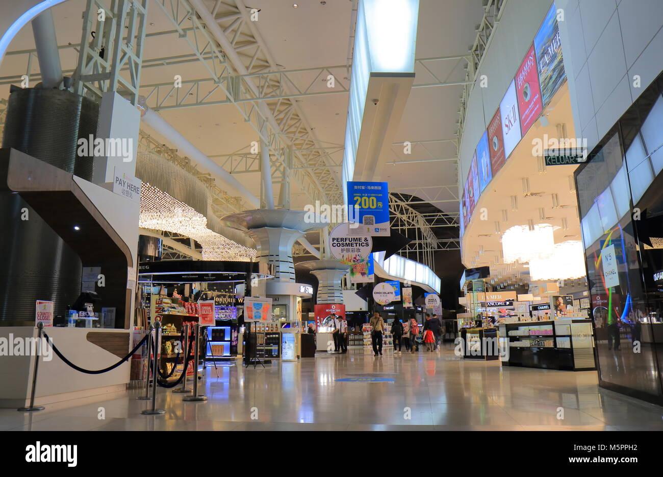 People visit duty free stores at Kuala Lumpur International Airport 2 Malaysia - Stock Image