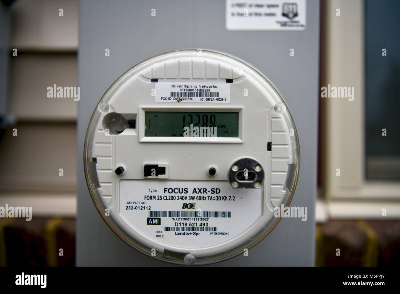 Energy meter reader on home, USA - Stock Image