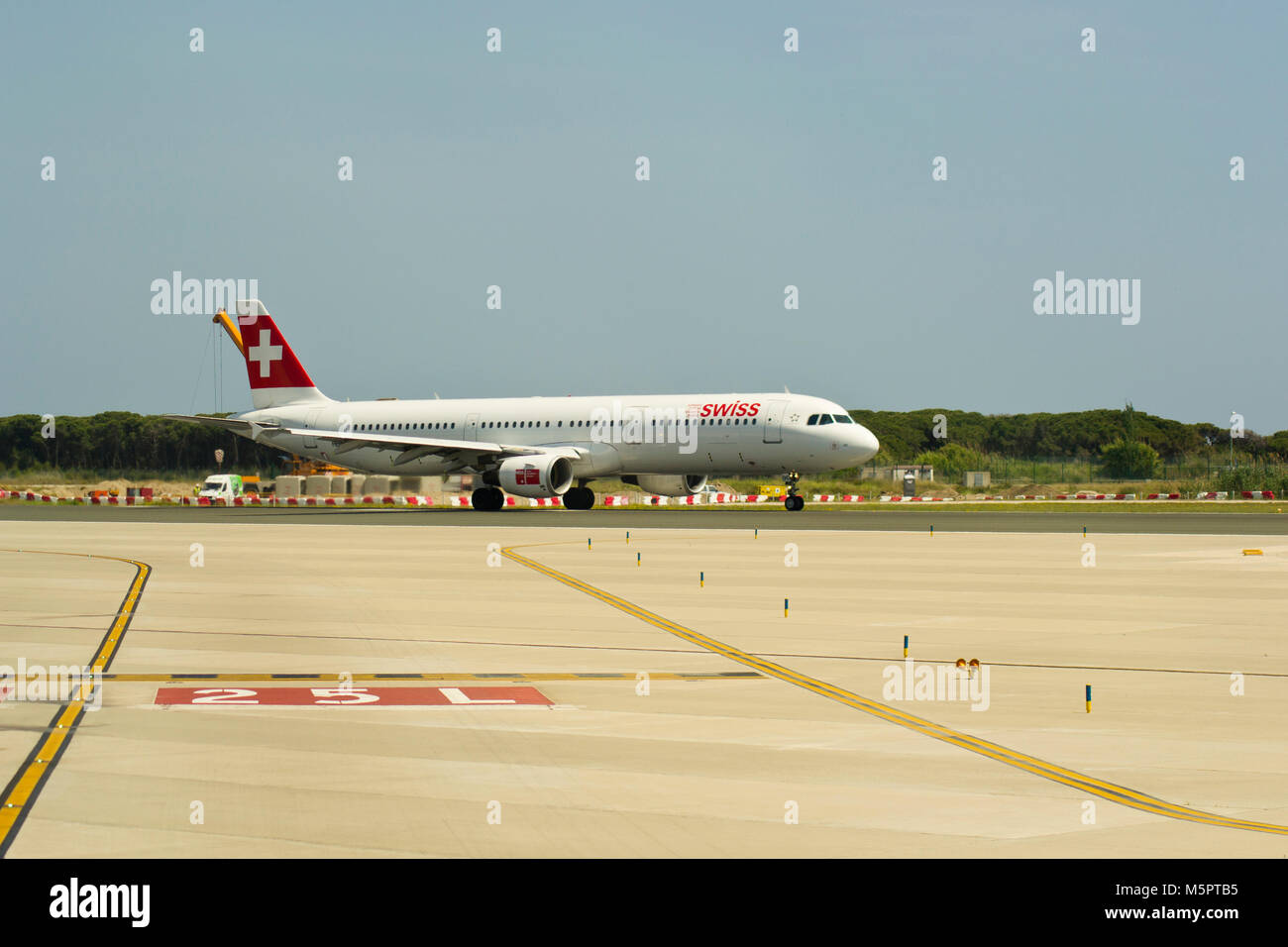 BARCELONA, SPAIN - MAY 30, 2012: A Swiss Airbus 321 starting take off run on from runway 25L in El Prat Barcelona Stock Photo