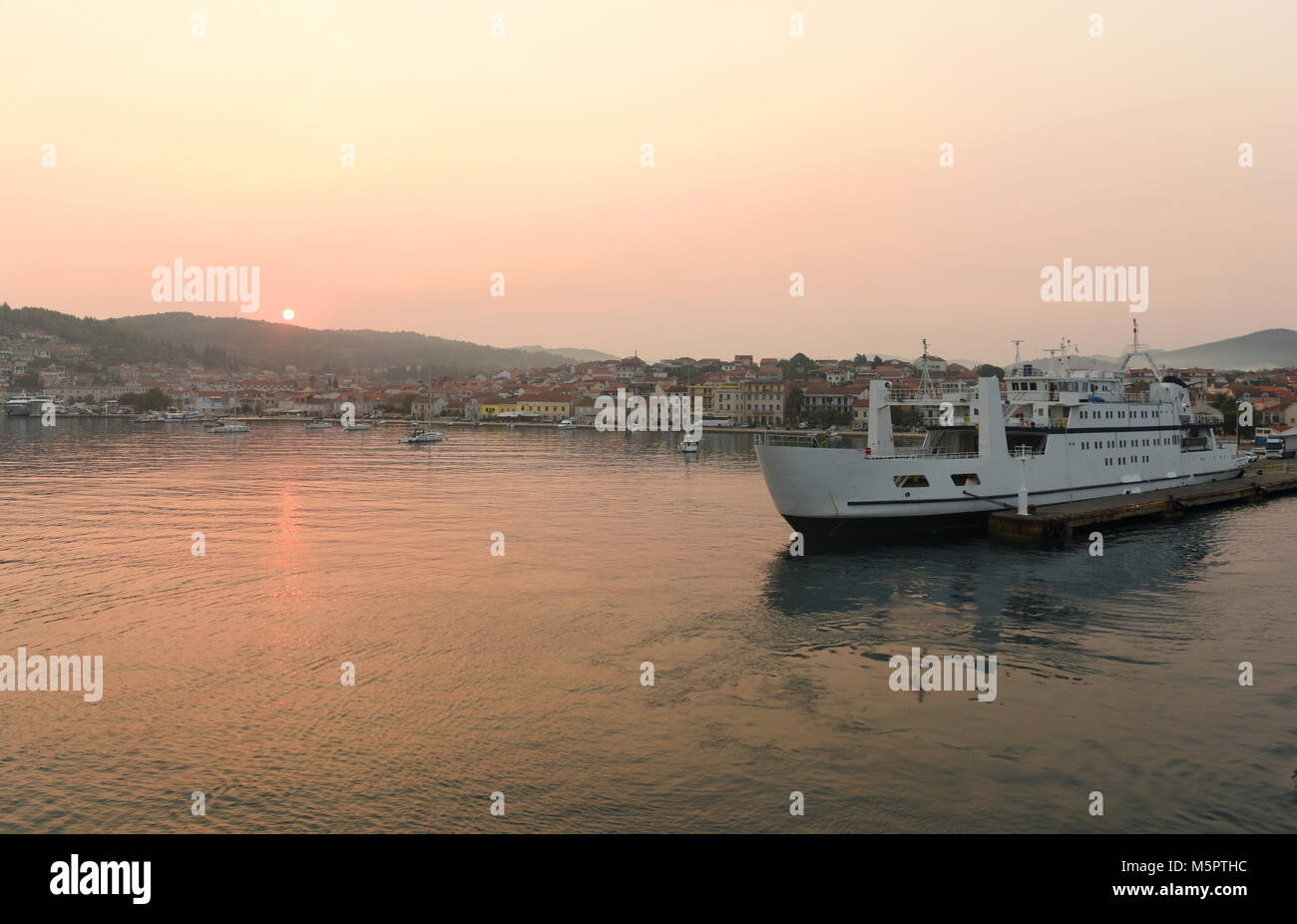 Sunrise in port of Vela Luka on island Korcula, Croatia. - Stock Image